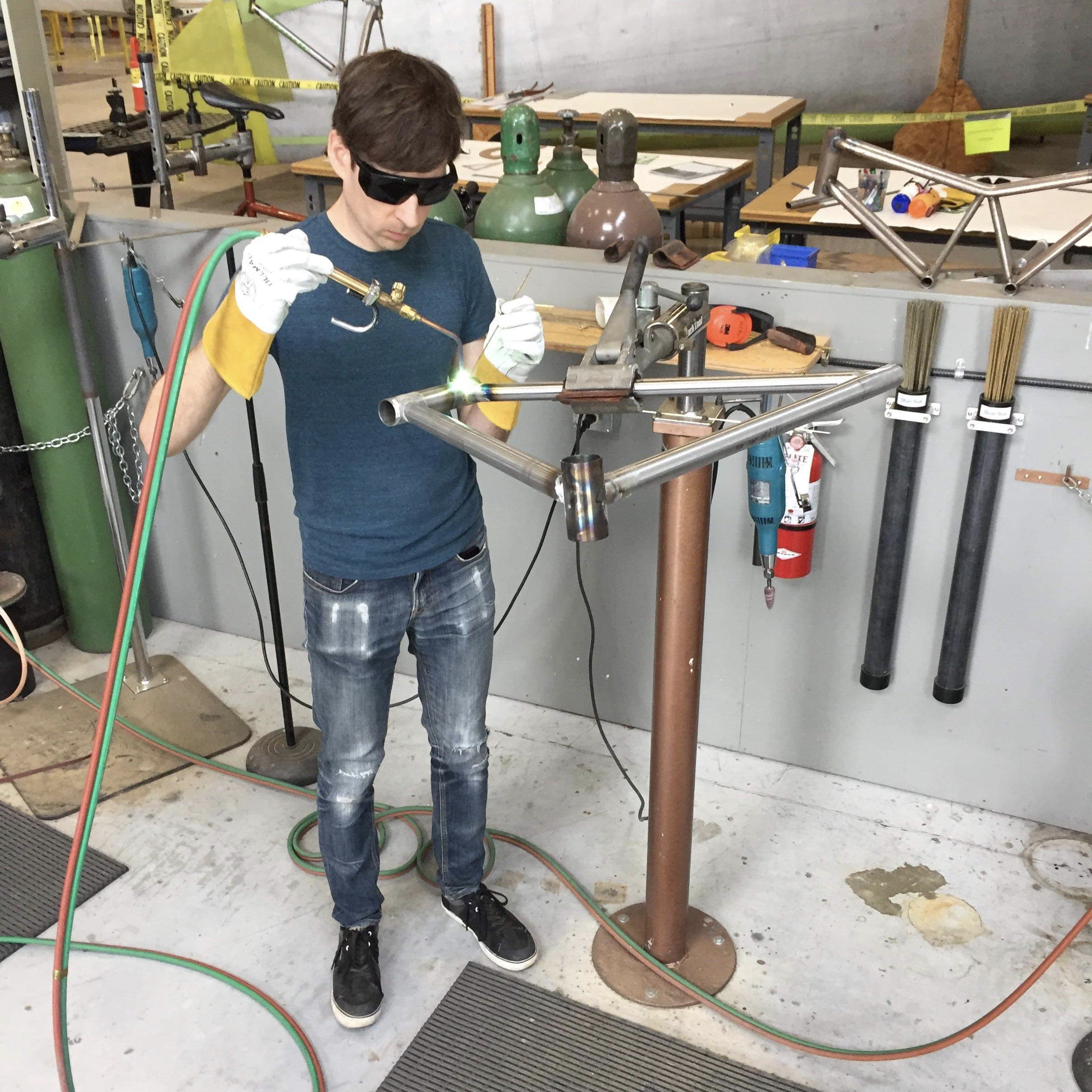 A man welding a bicycle frame