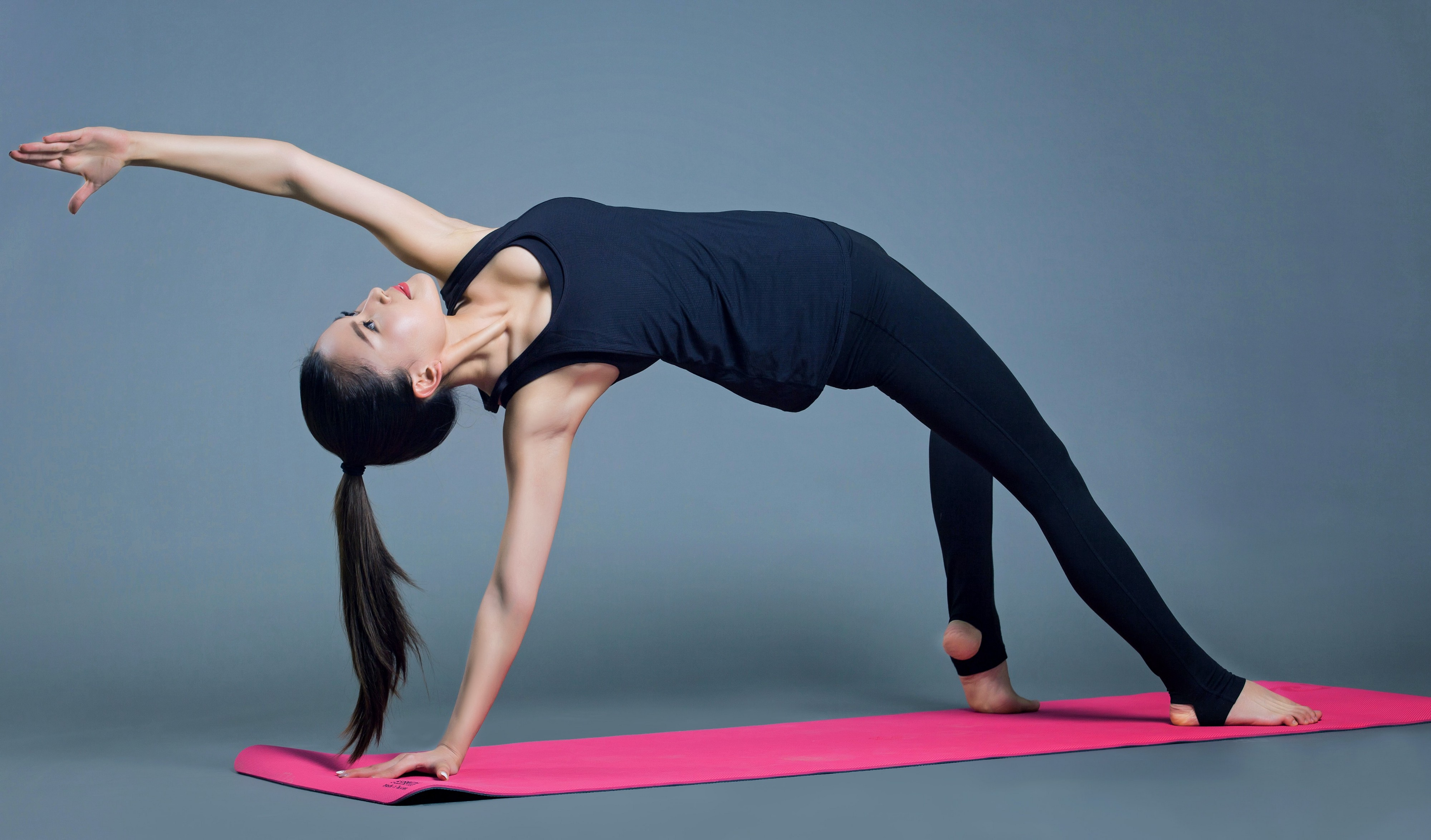 Woman doing yoga on a mat.
