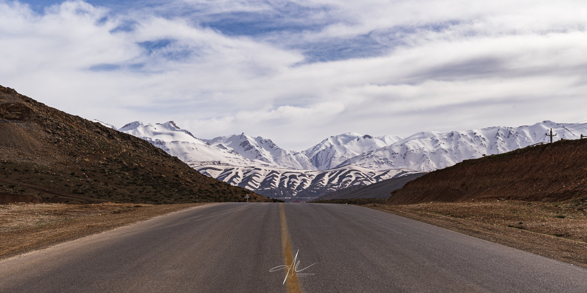 A stunning view of the mountain ranges from the middle of a highway in Zagros Mountain.