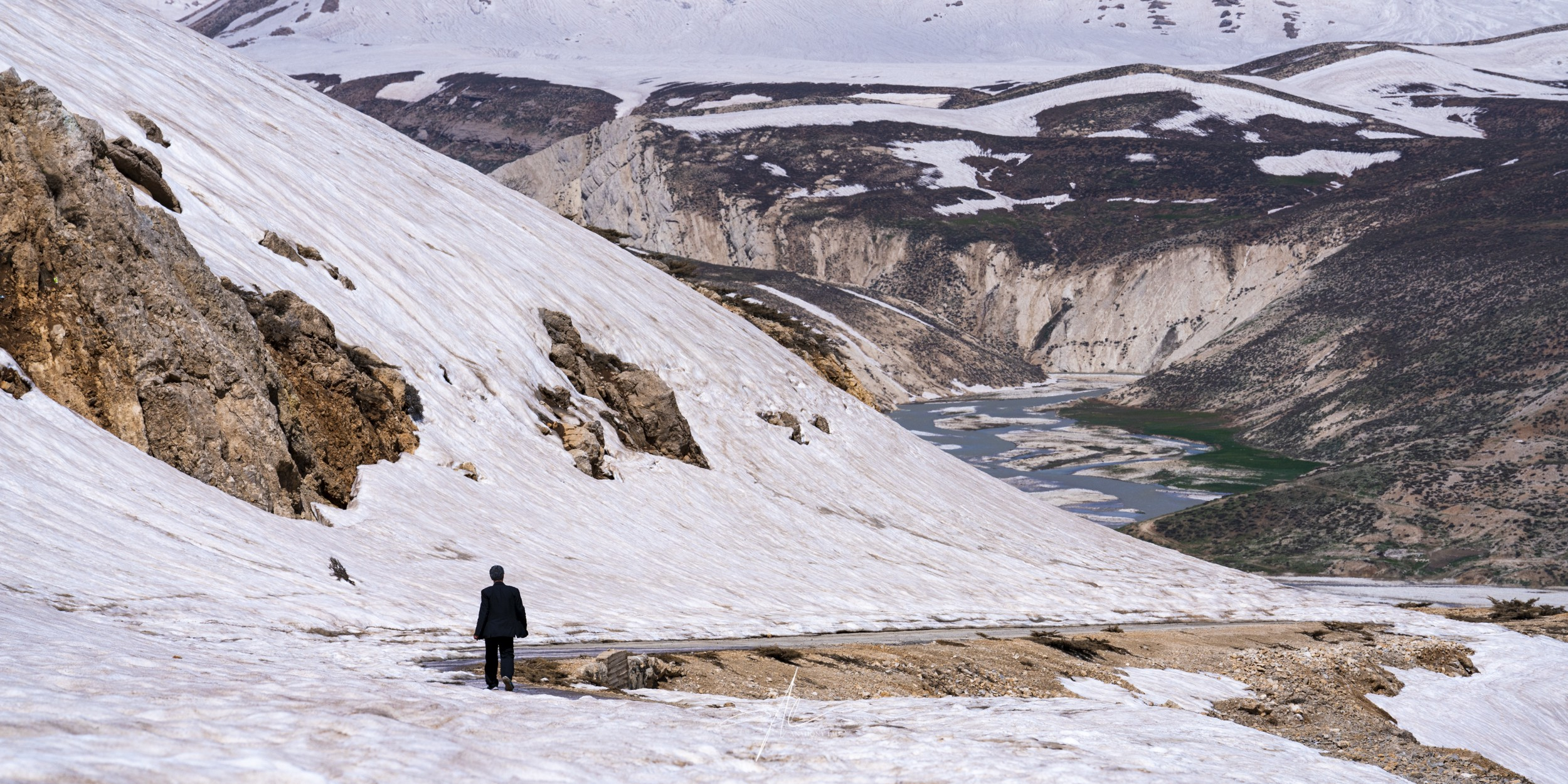 As I was capturing the amazing glacier, a man walked into my frame and continued his way home.