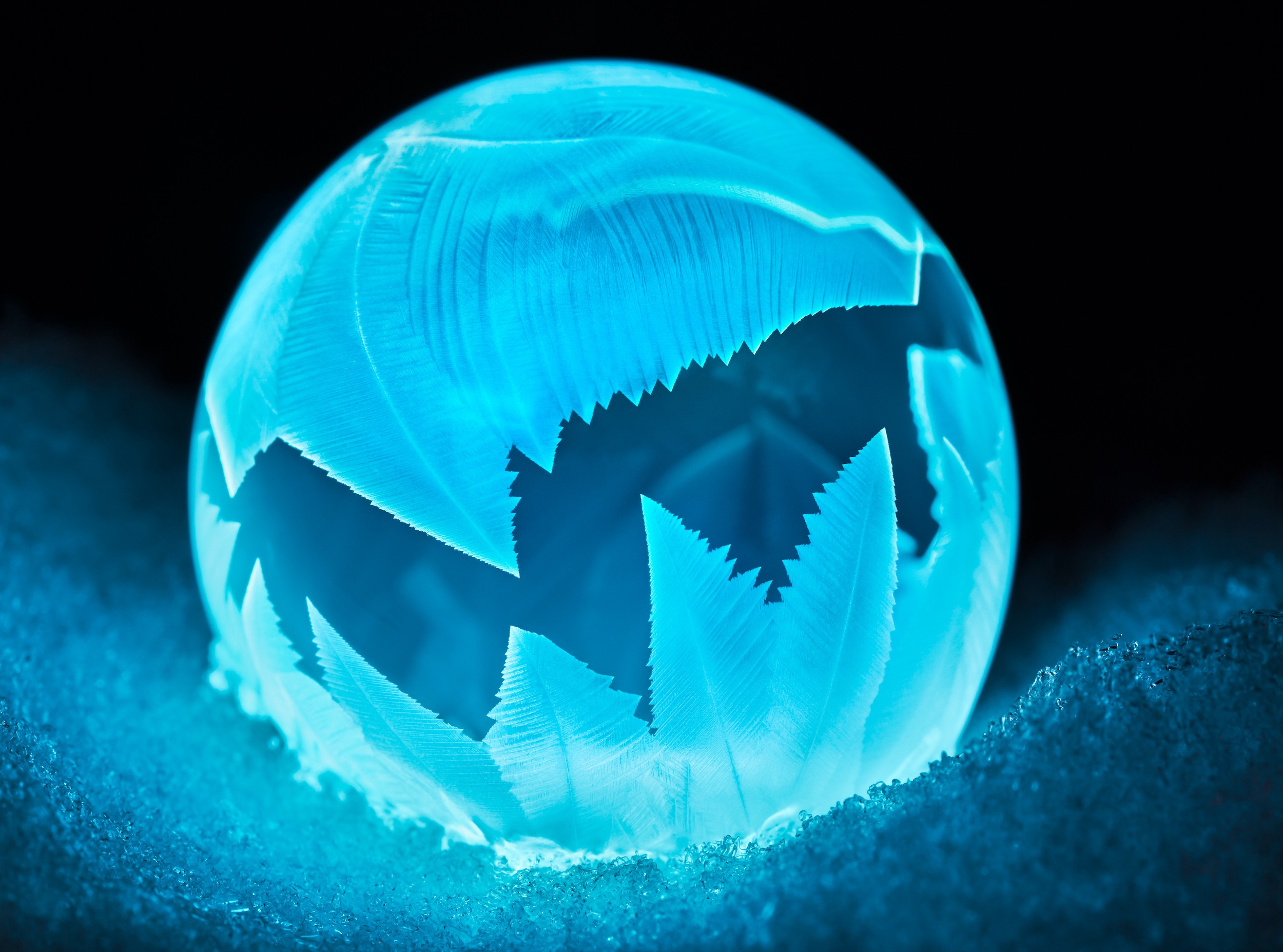 A photo resulting from a scientific experiment shows a glowing blue bubble with a jagged color pattern
