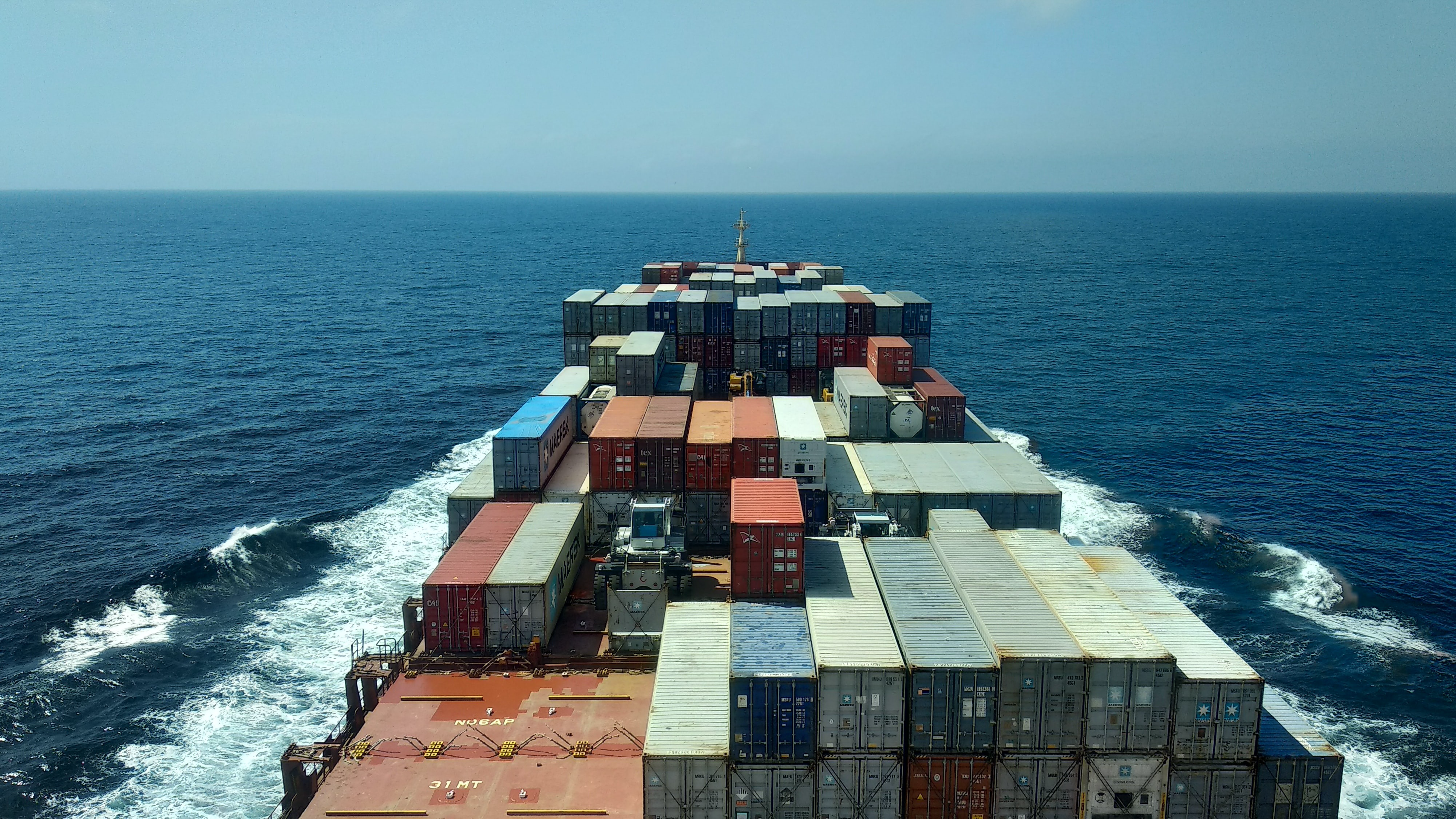 Picture of a container ship sailing on sea