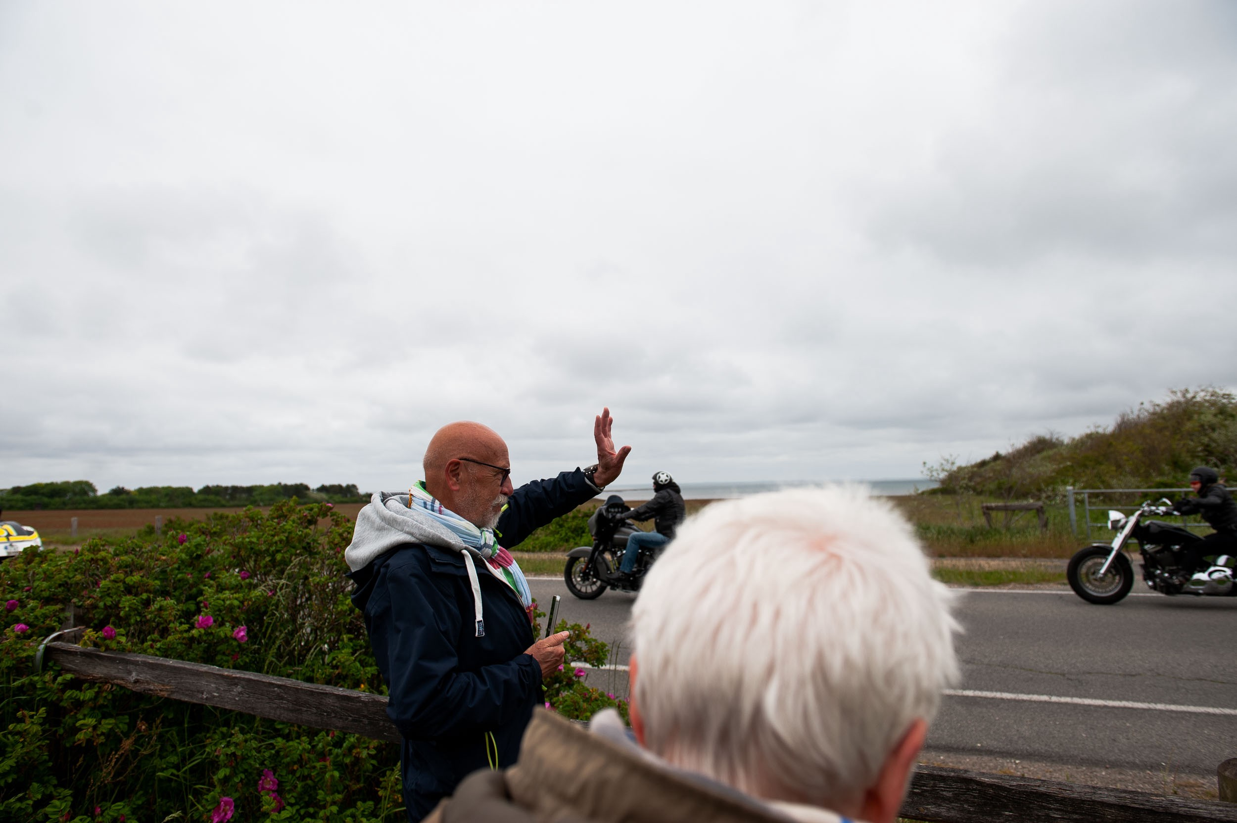 Dad waves at the participants of the Harley Davidson parade that was crossing the island. Sylt, Germany, May 25, 2019.