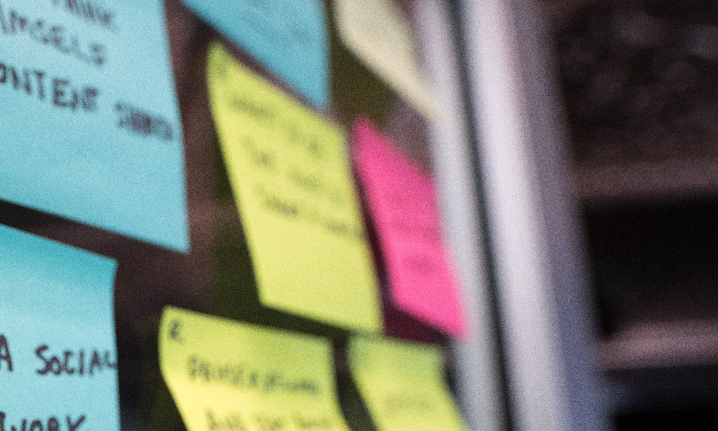 A wall of Post-it notes in a design thinking session.
