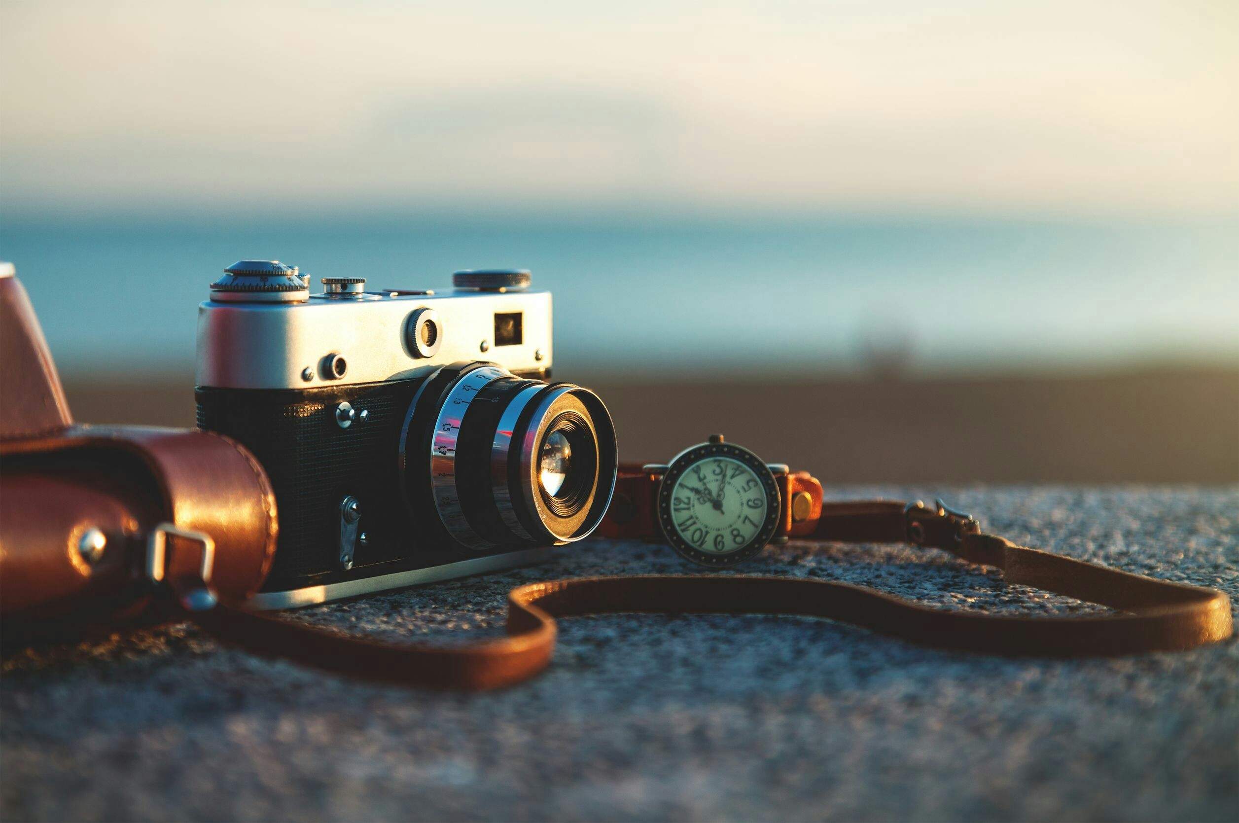 A photo of a close-up of a camera on a rock.