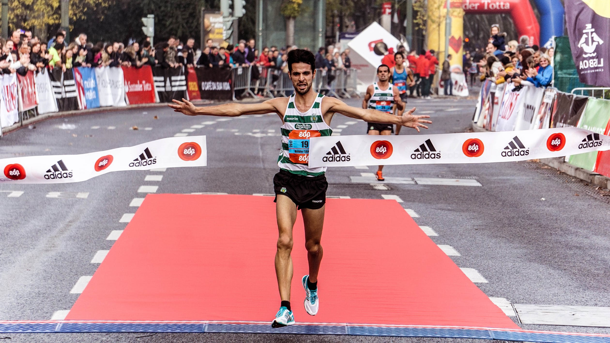 Image of runner crossing a finish line