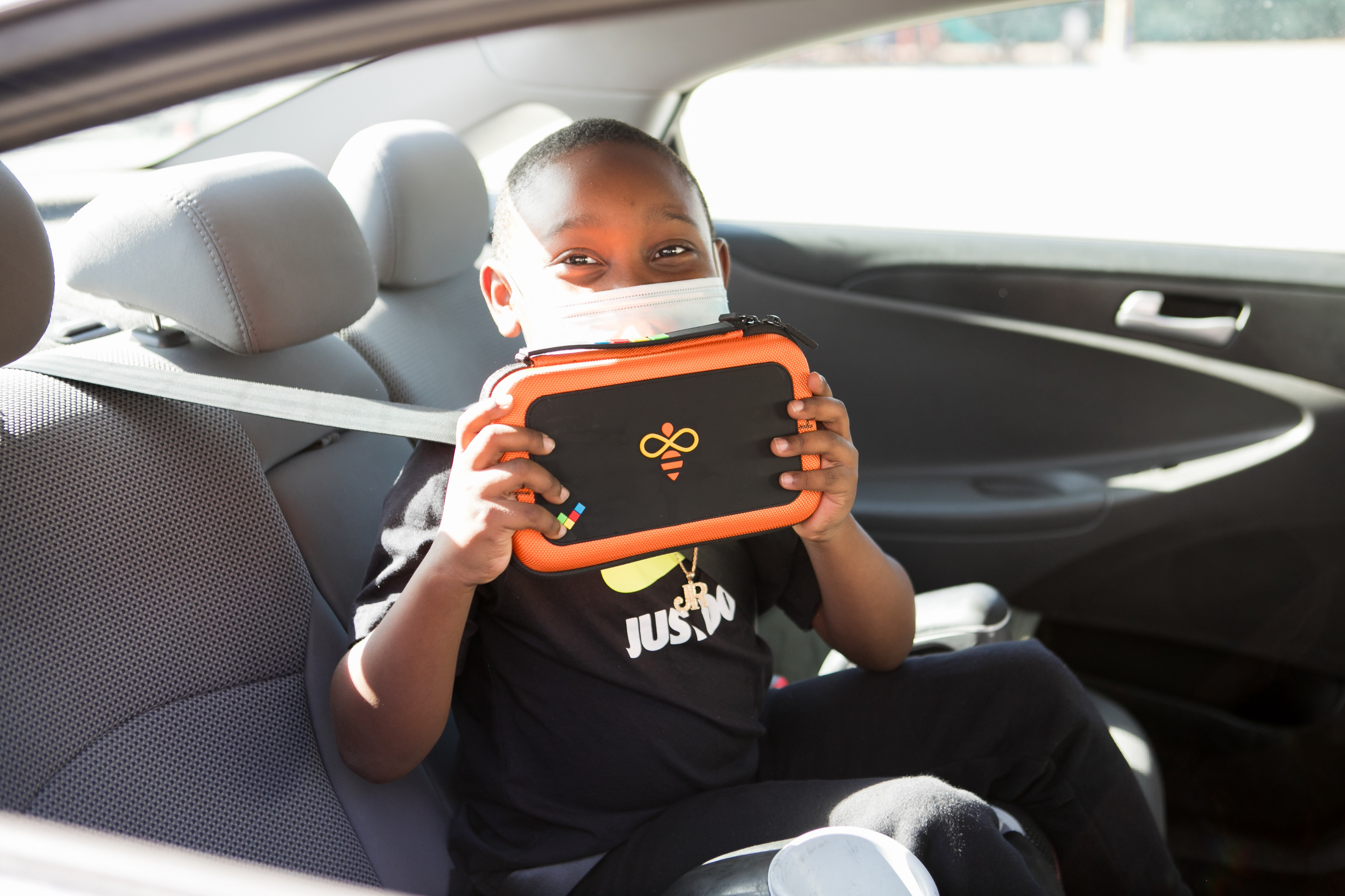 An Aspire student proudly shows their newly received onetab device.