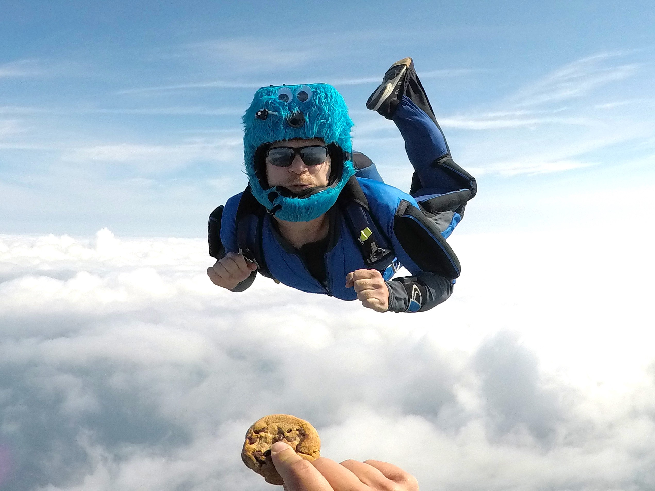 A photo of the author skydiving towards a cookie.