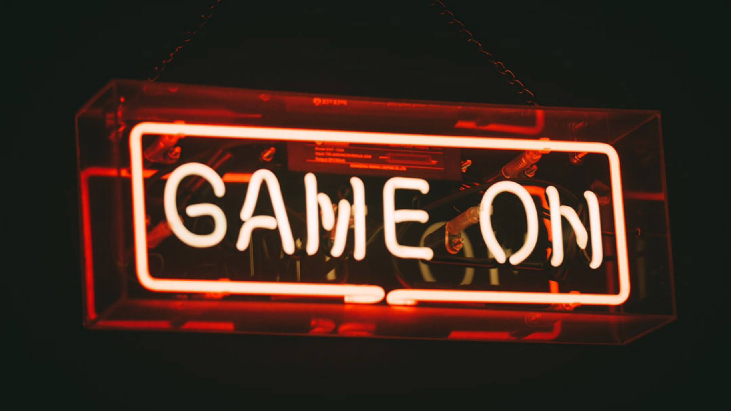 Neon sign reading 'Game on'