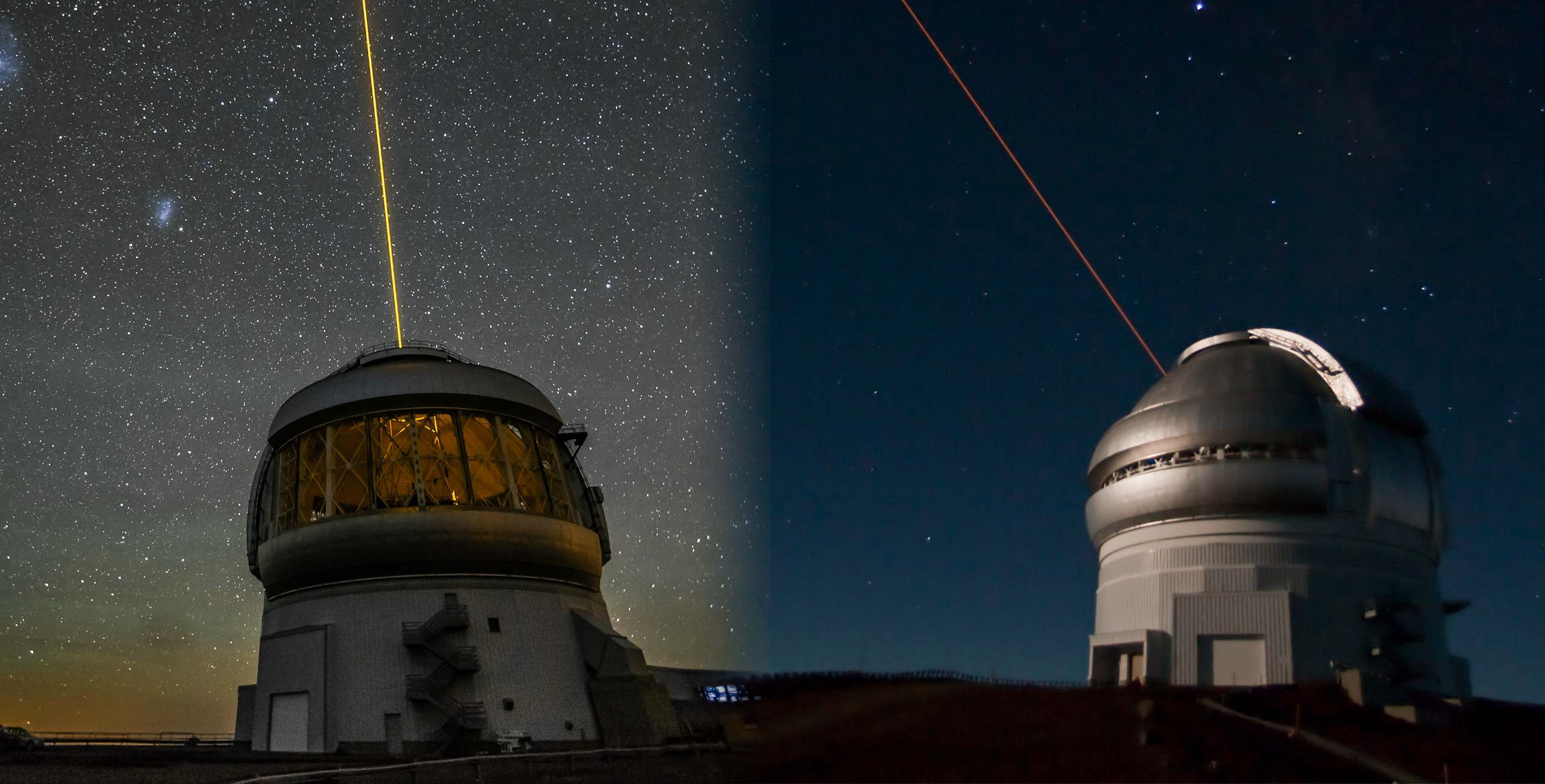 A pair of telescope domes, as one fires a laser into the sky.