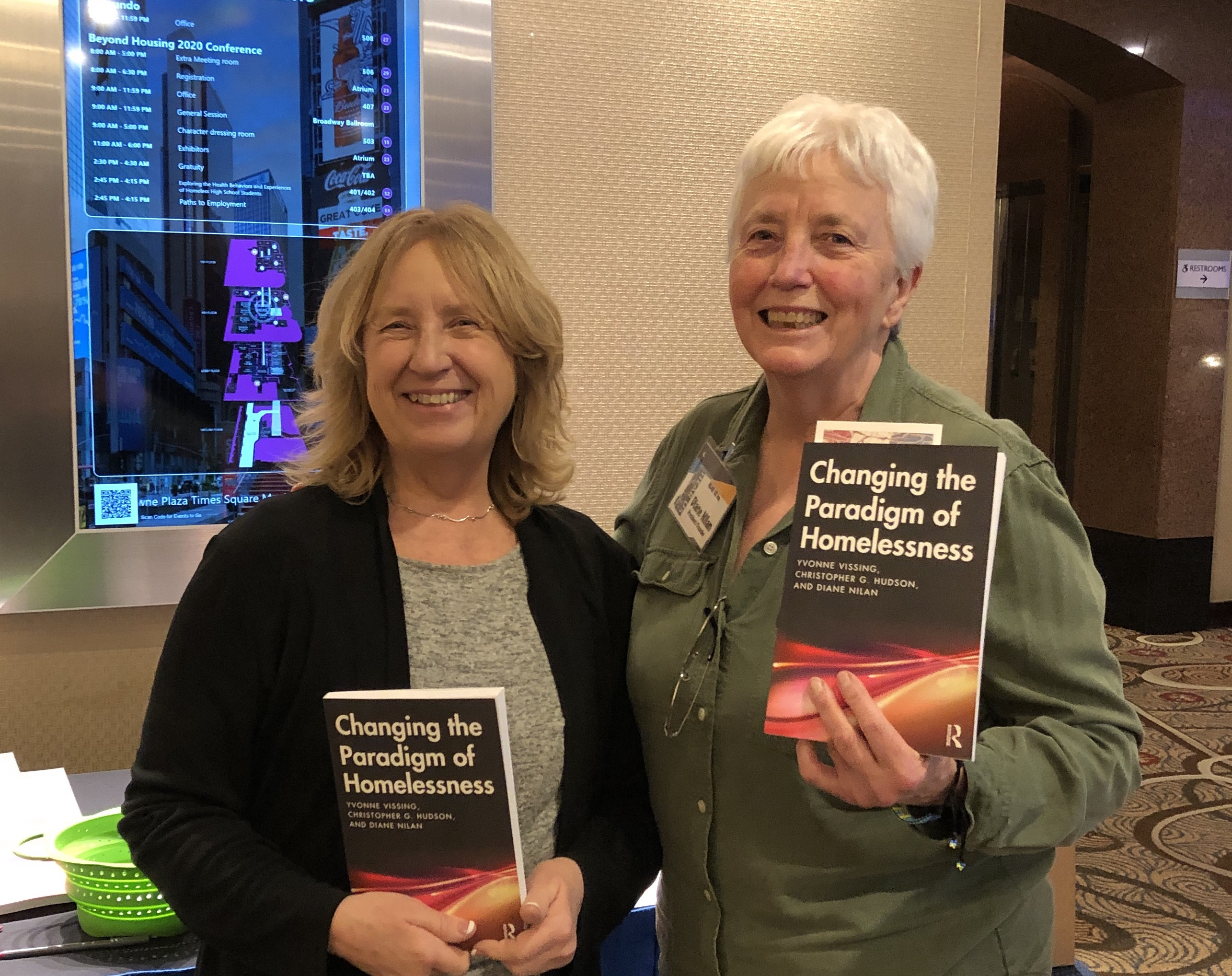 yvonne vissing (left) and diane nilan with their new textbook, changing the paradigm of homelessnss