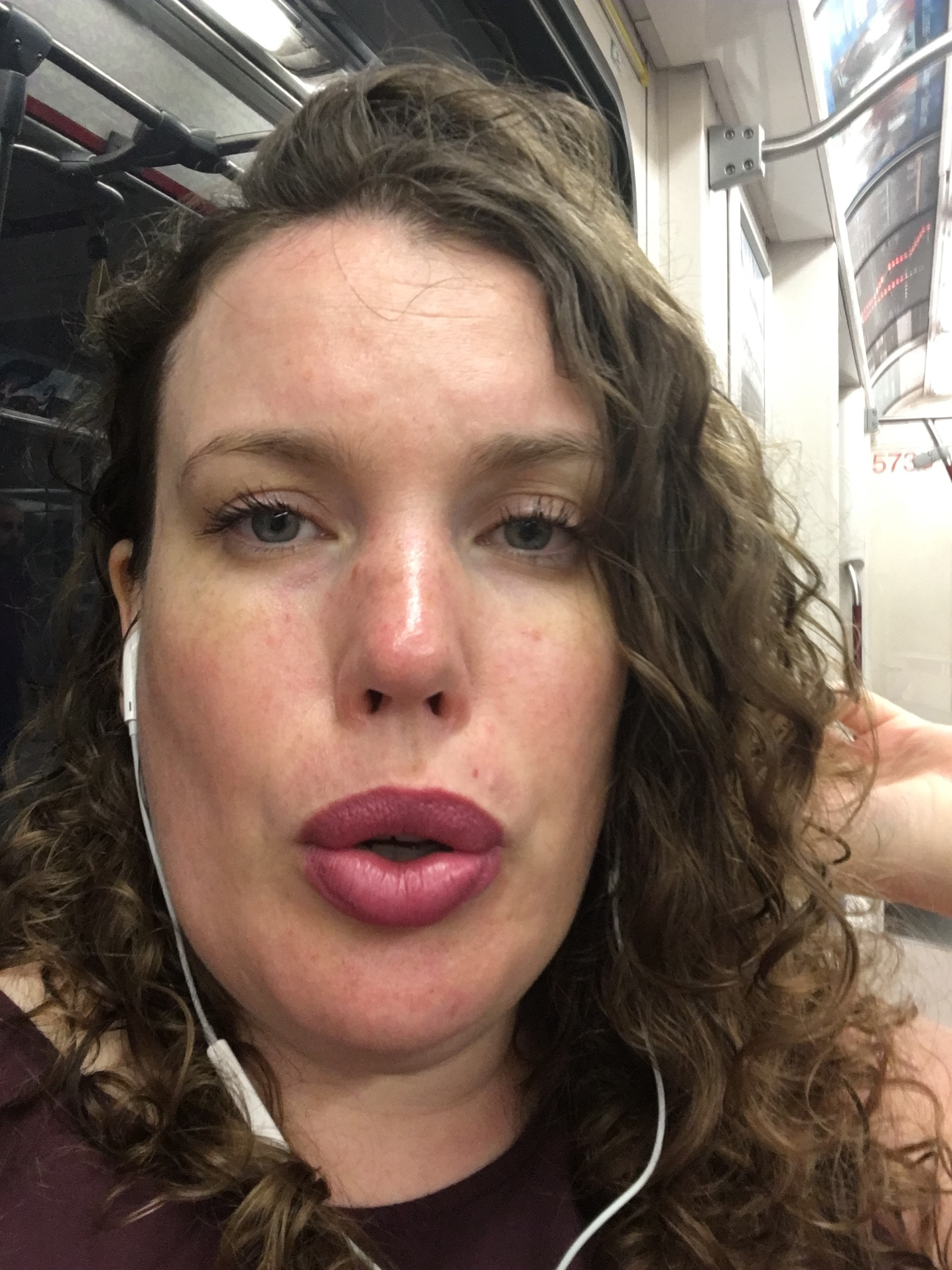 Picture description: Me on the subway, lips pressed in a breathing exercise, trying to reduce my anxiety before work.