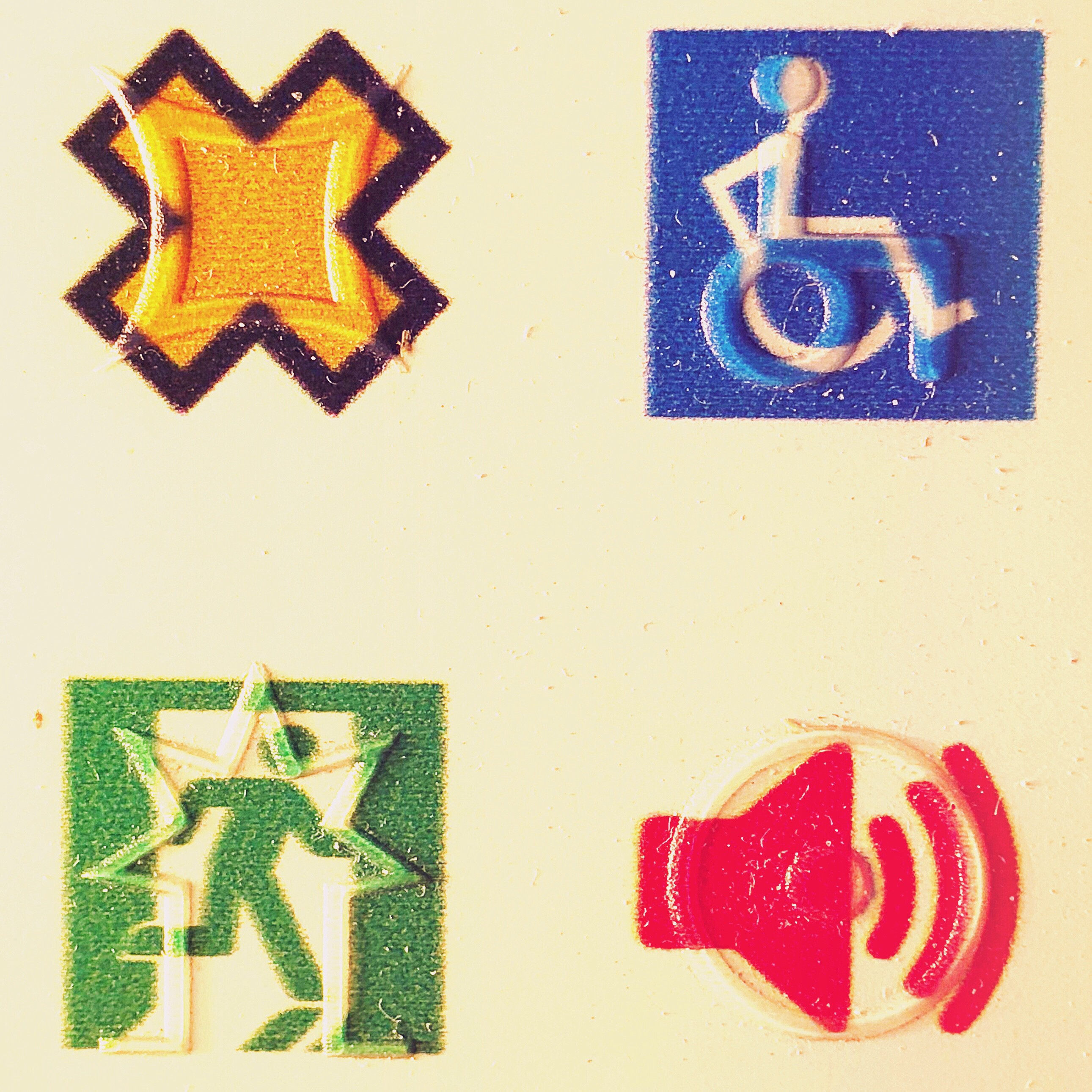 4 visual symbols with tactile symbols overlaid. The tactile symbols do not replicate the visual but are designed for touch