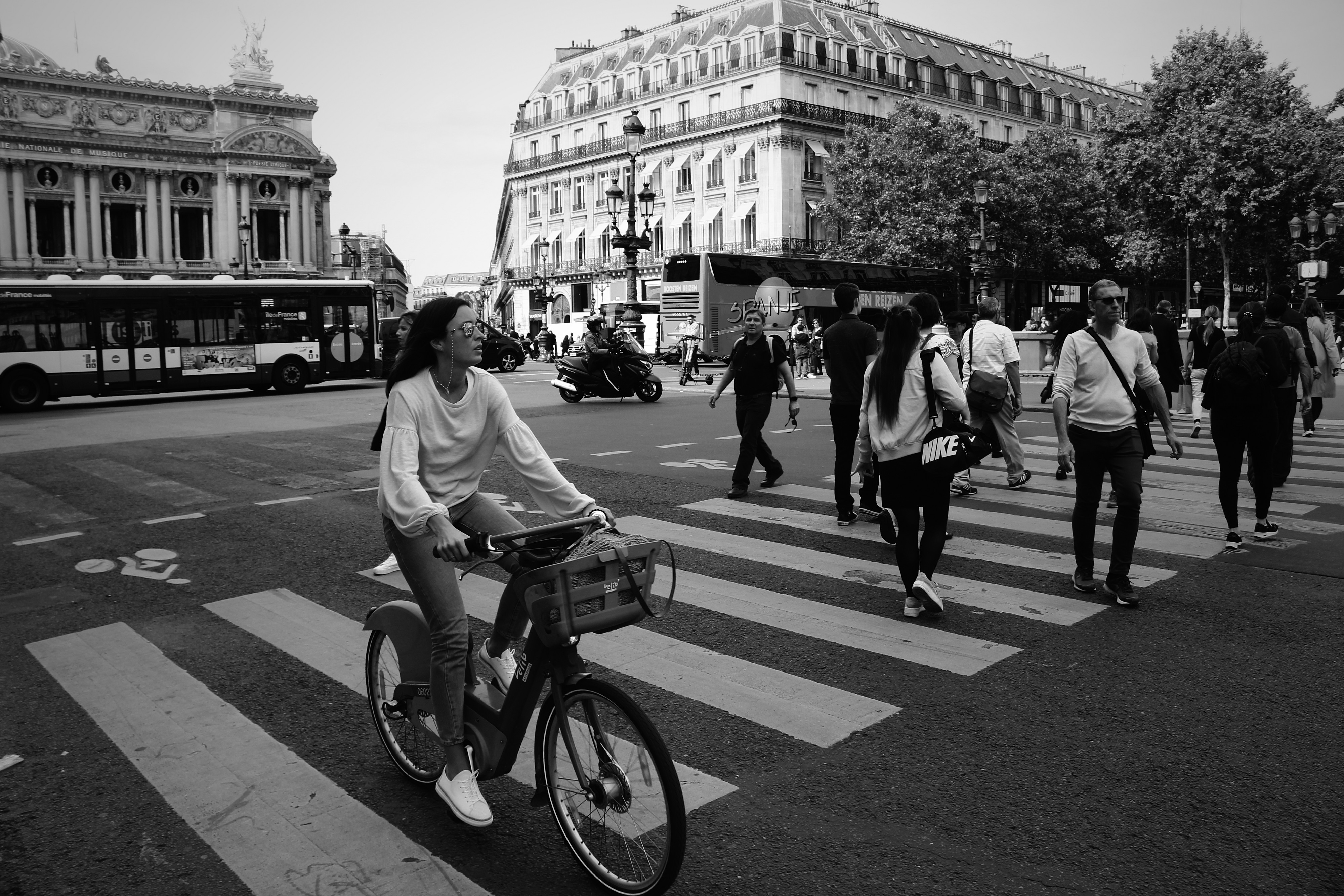 Cyclist on a level crossing with people - Photo by Steven Lasry on Unsplash
