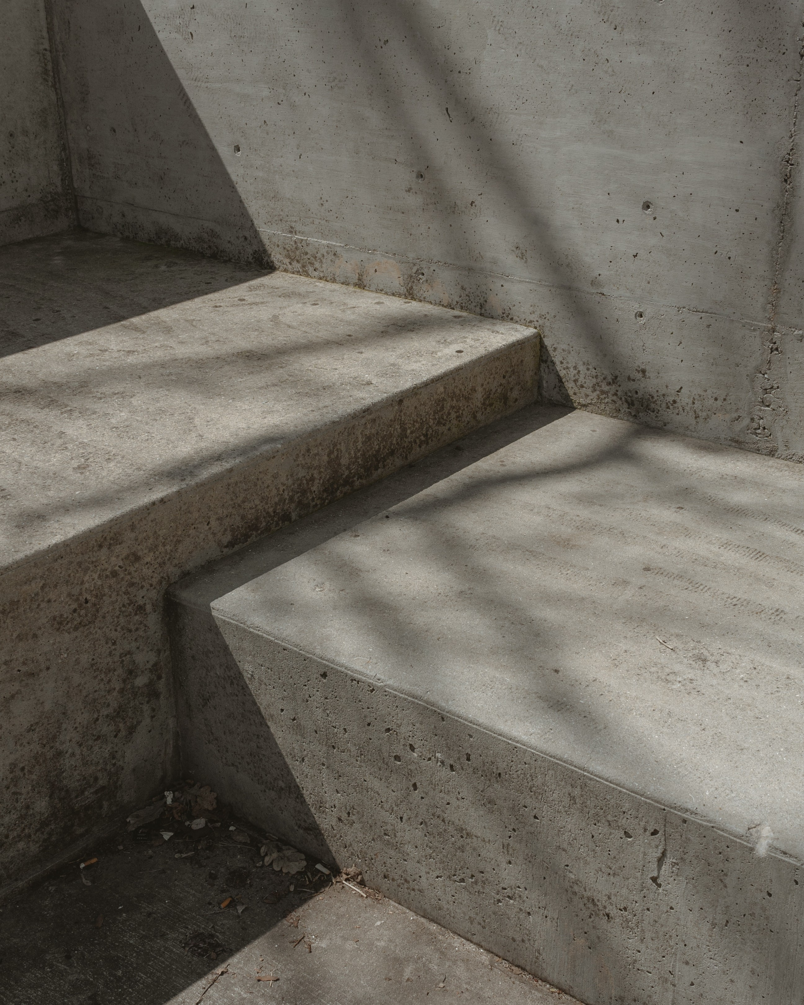Concrete steps with no curb cut or handrails