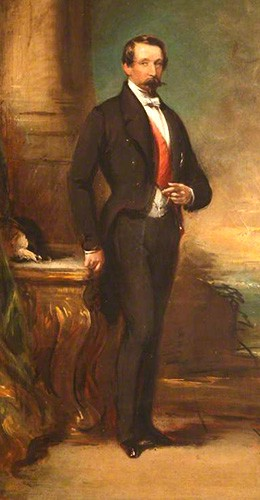 Louis Napoleon Bonaparte painted wearing a black suit and red sash. He has dark hair and a horizontal mustache.