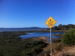 A sign warning people about nearby quicksand.