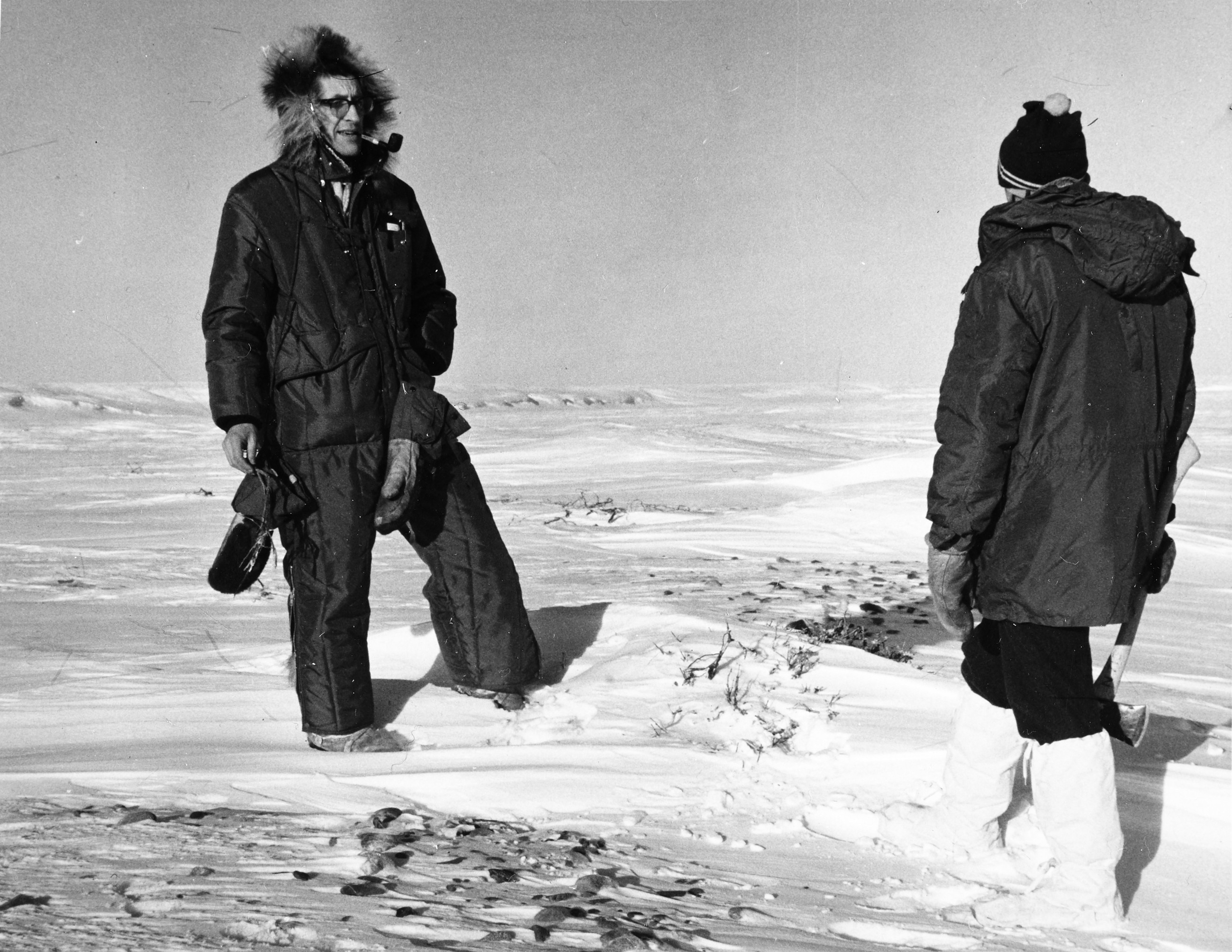 two men standing in the snow in Alaska, black and white photo