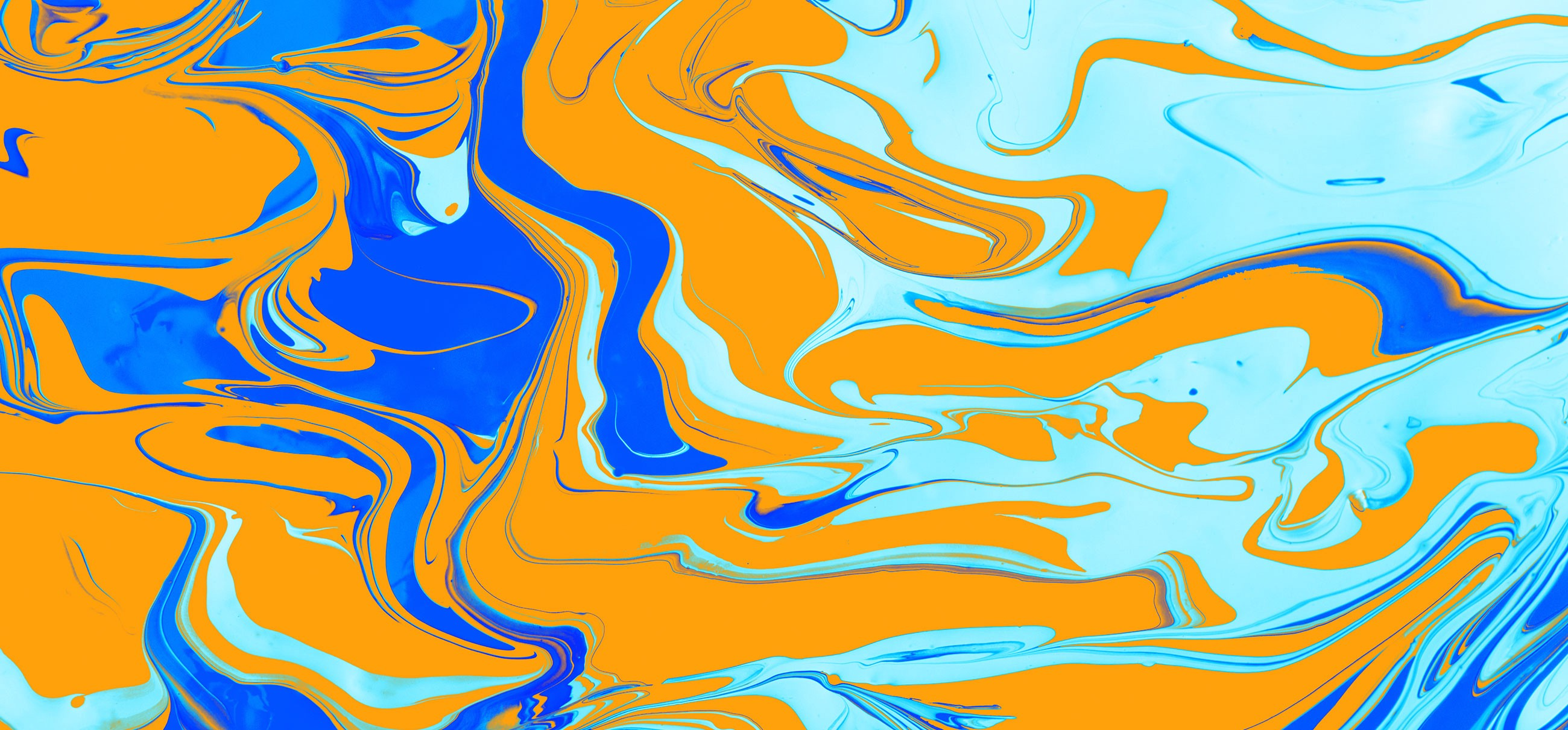 Orange swirls among a smaller amount of blue swirls