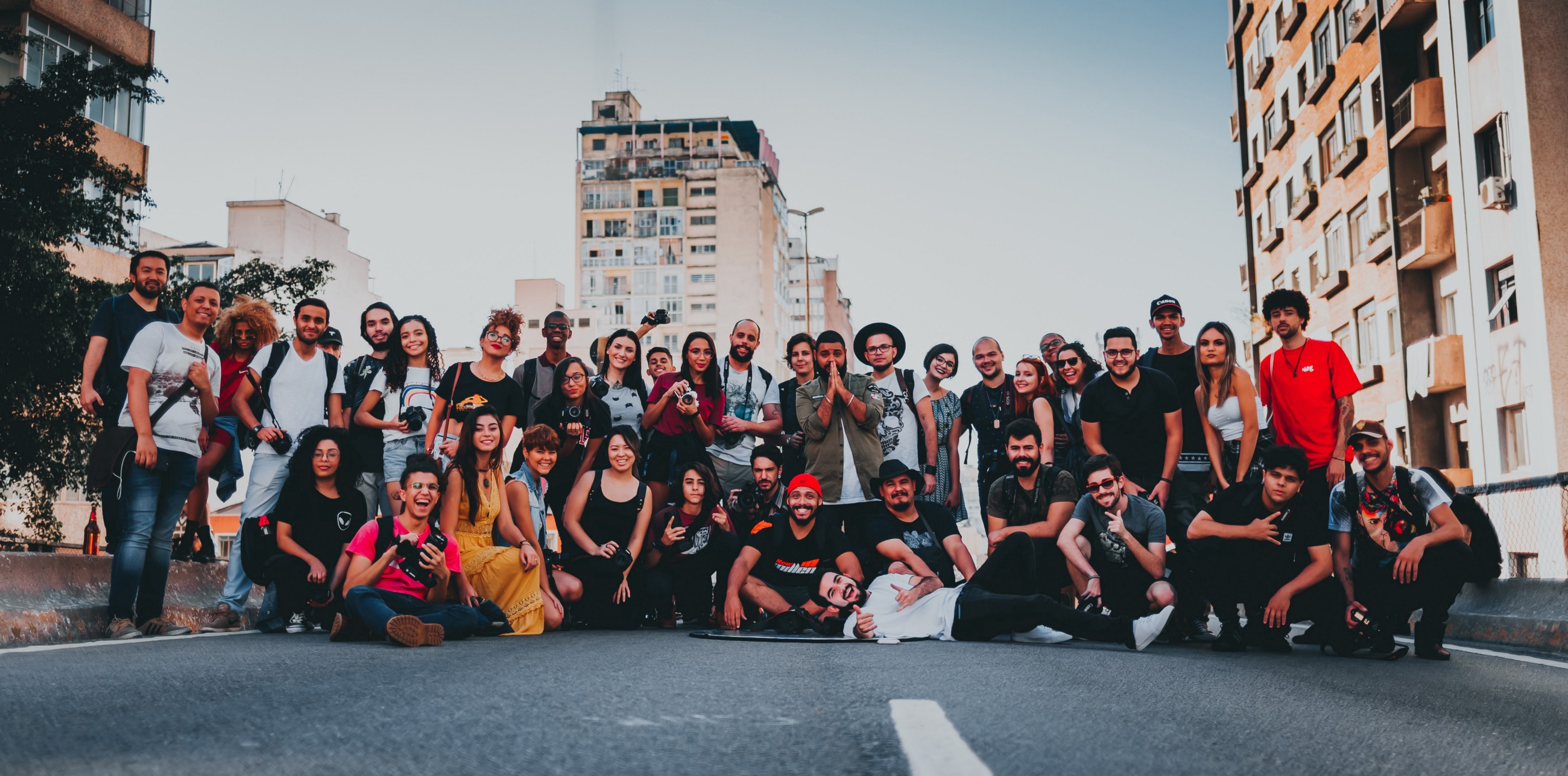 A group of diverse people posing for a photo