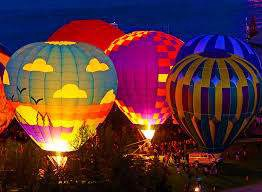 lighting the balloons lighting up the early morning with color