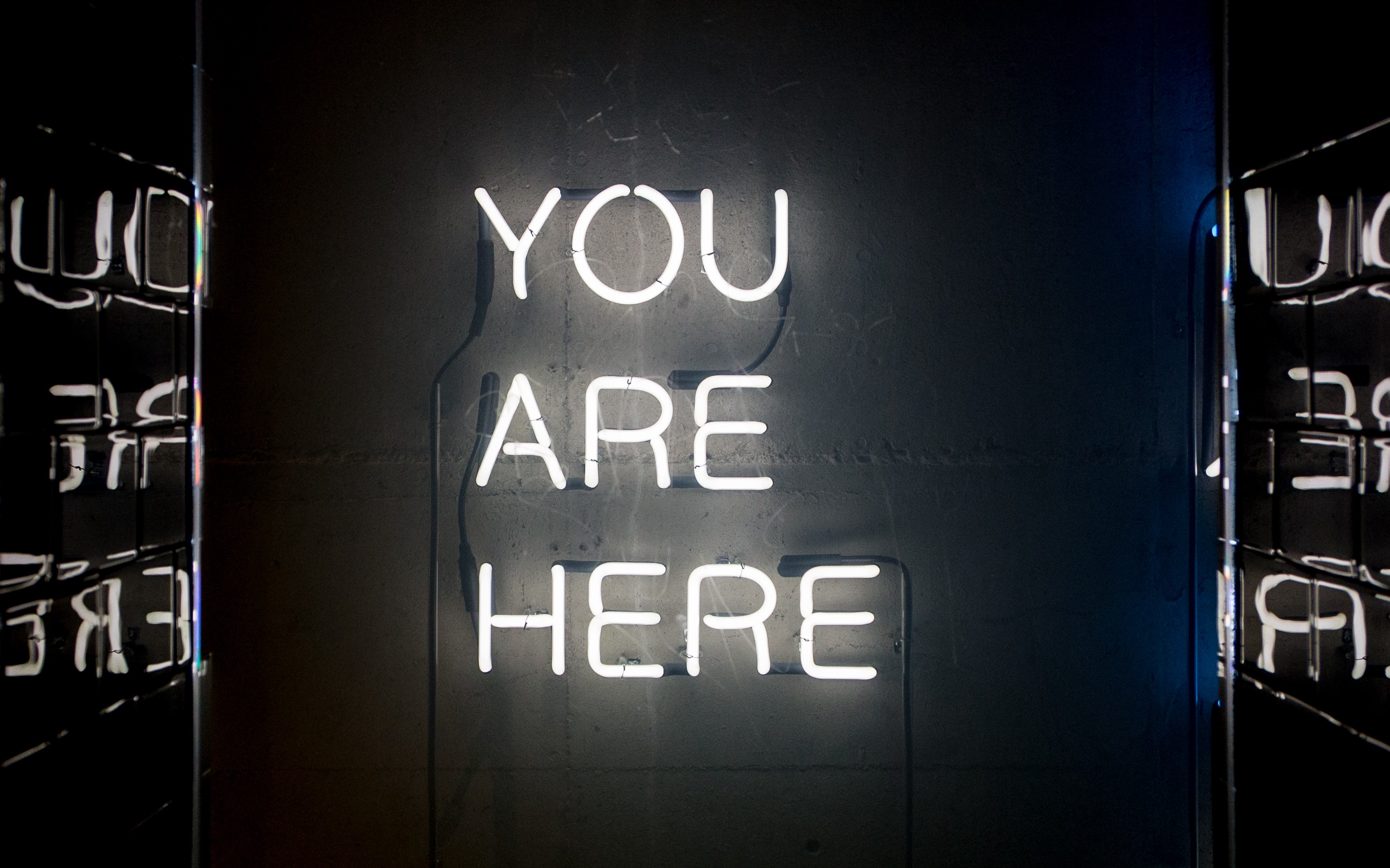 """The words, """"You are here"""" on a wall"""