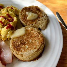 Crumpets on a plate with butter melting on them