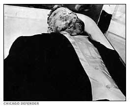 The body of Emmett Till shown before an open casket funeral.