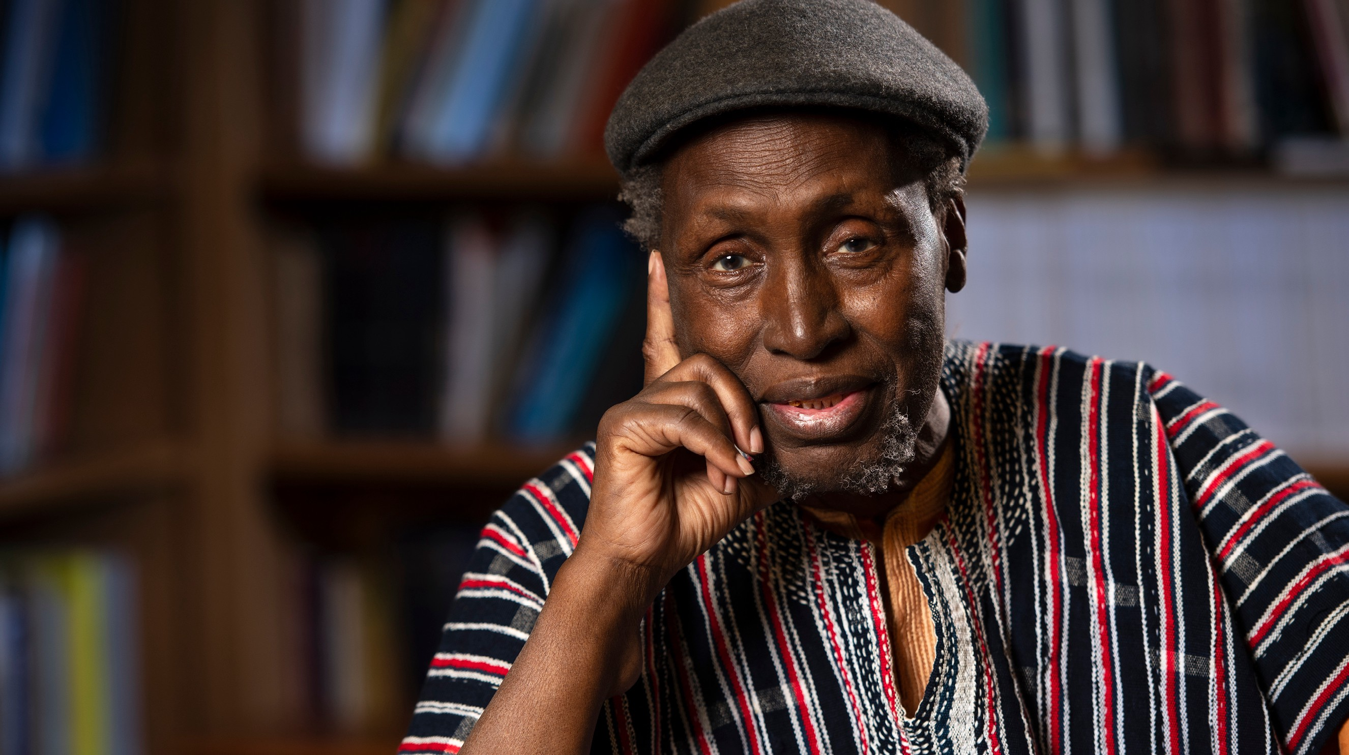 Ngugi wa Thiong'o rests his hand in his right hand in a thinking gesture