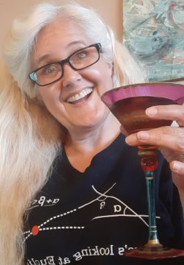 The author holding a martini and making a goofy face