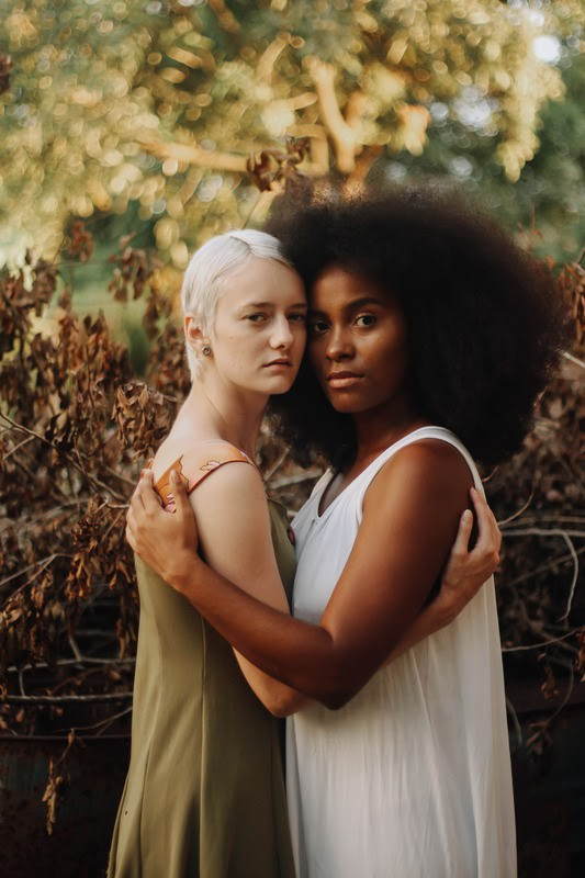 Two women, one black and one white, standing together