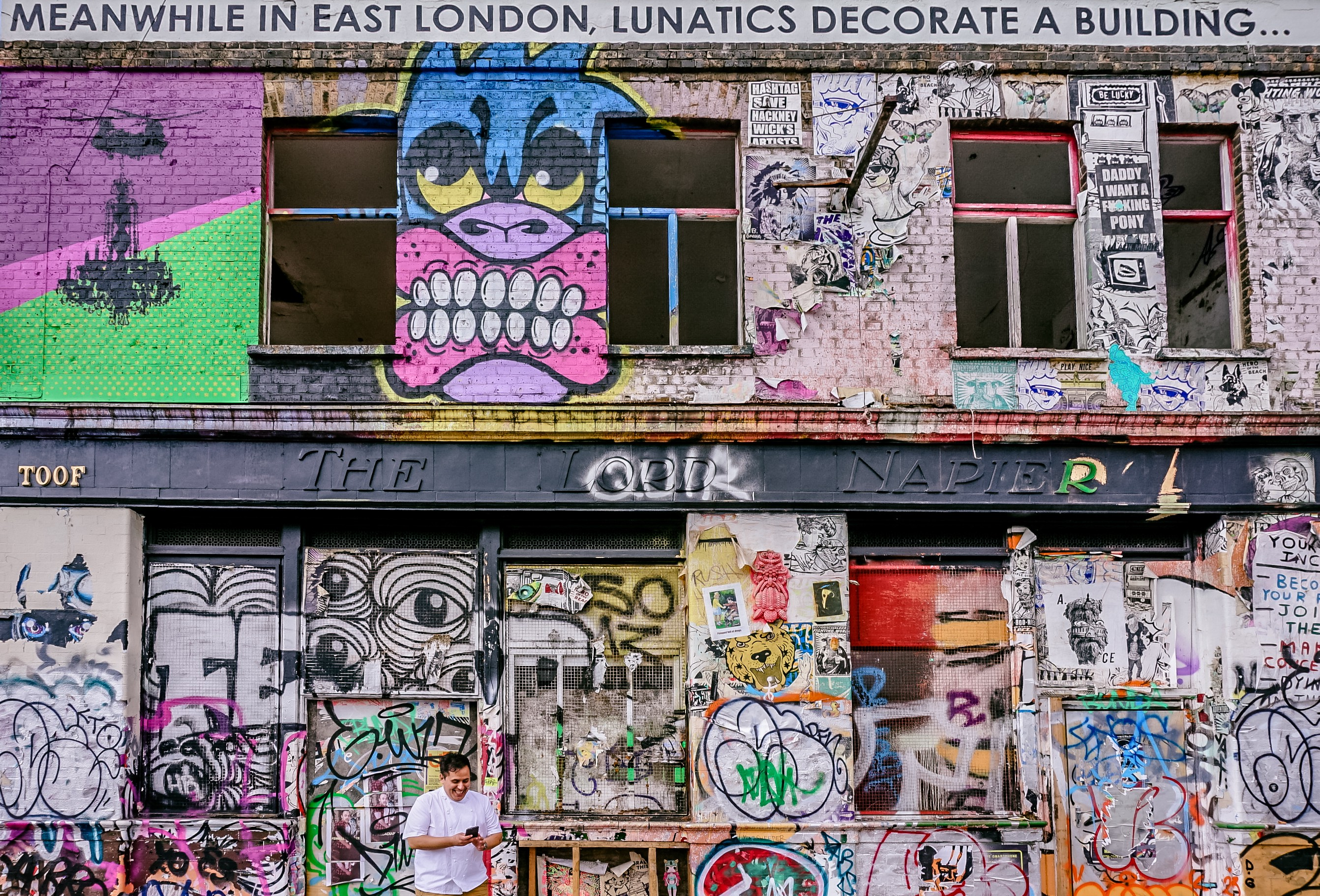 An abandoned building covered in graffiti in East London
