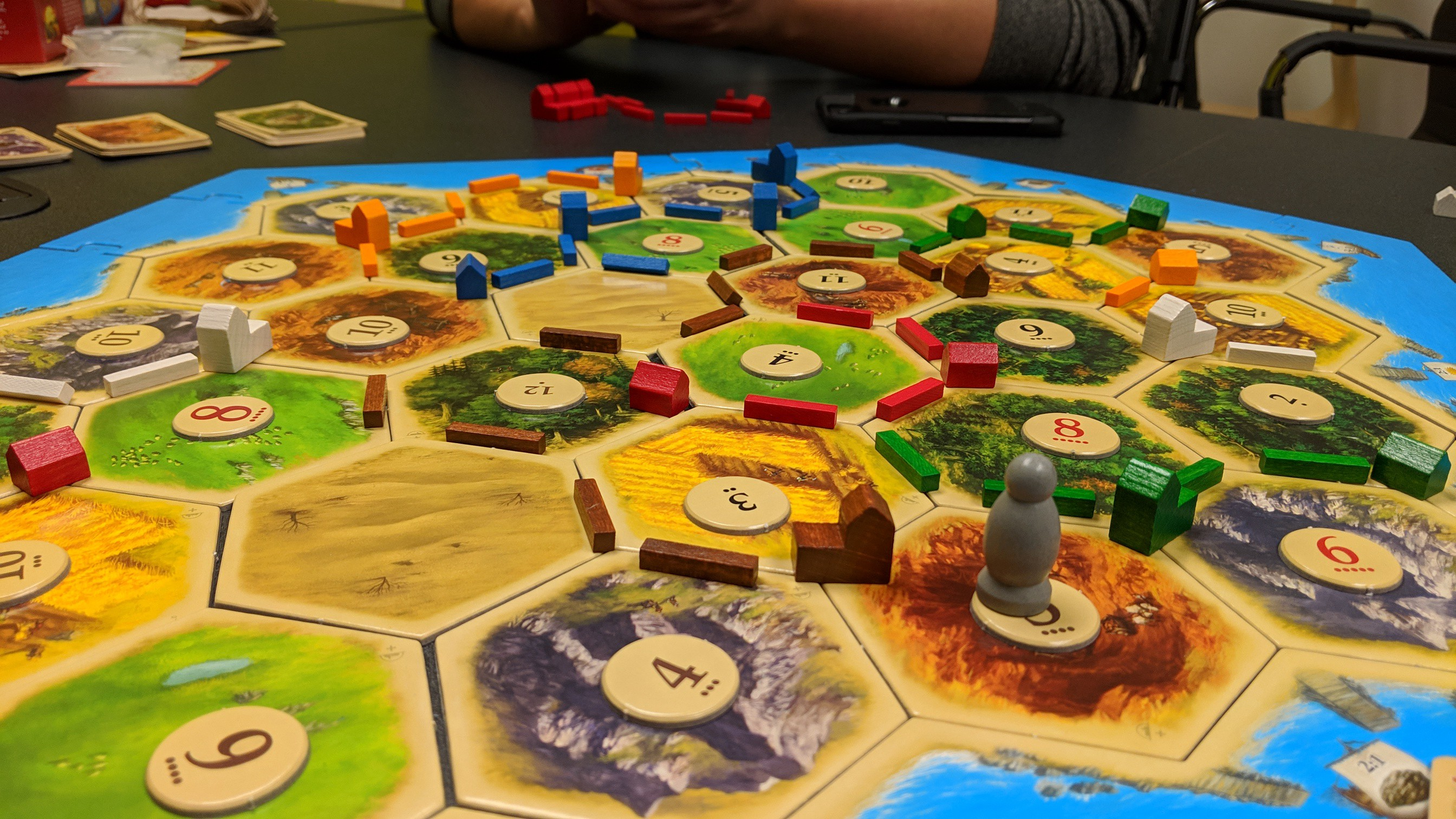 A table setup with the boardgame, Settlers of Catan