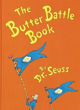 The butter battle book by Dr. Seuss. A character holding a flag with an image of bread with butter.