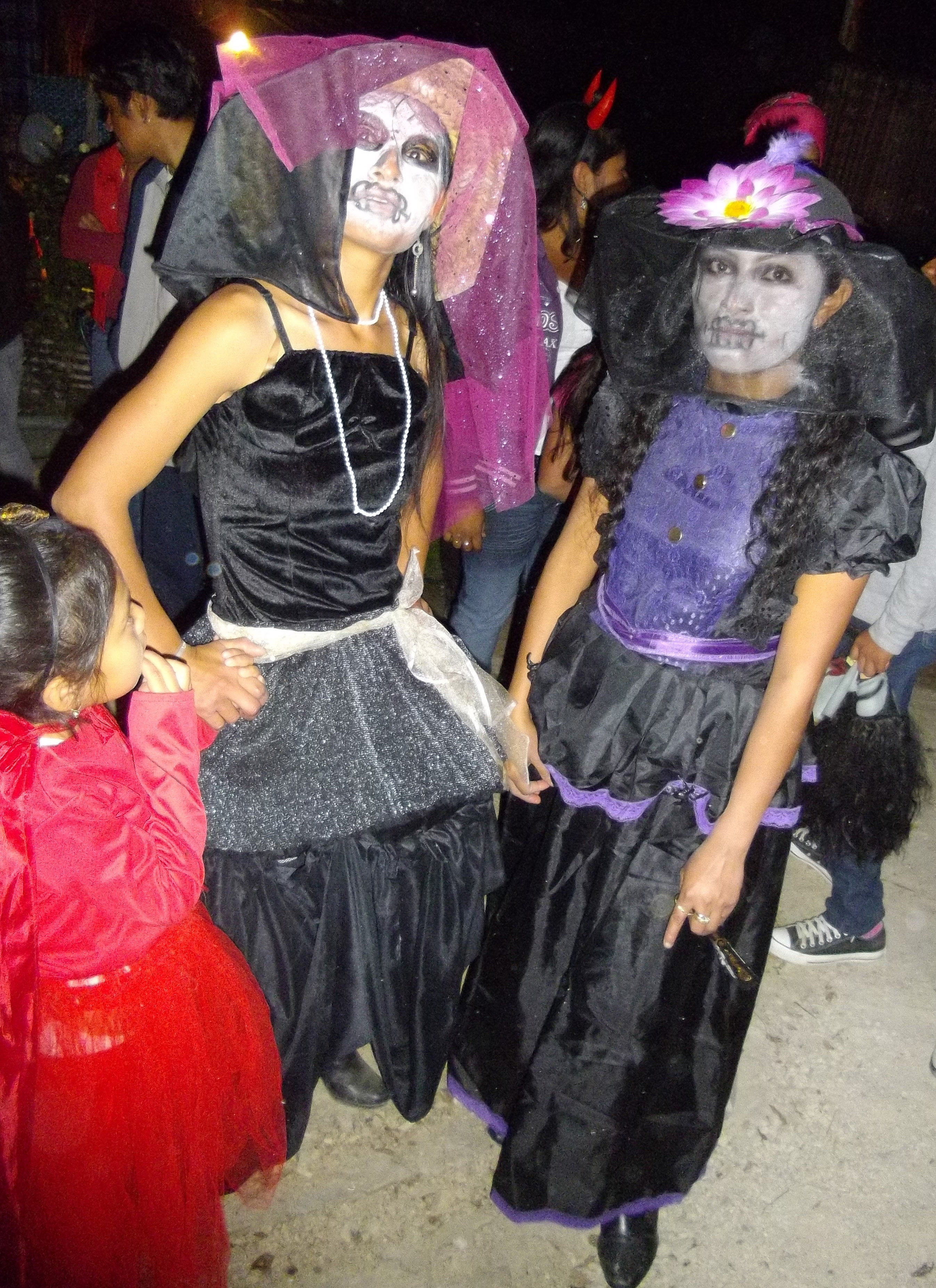 Day of dead teenagers dressed as witches