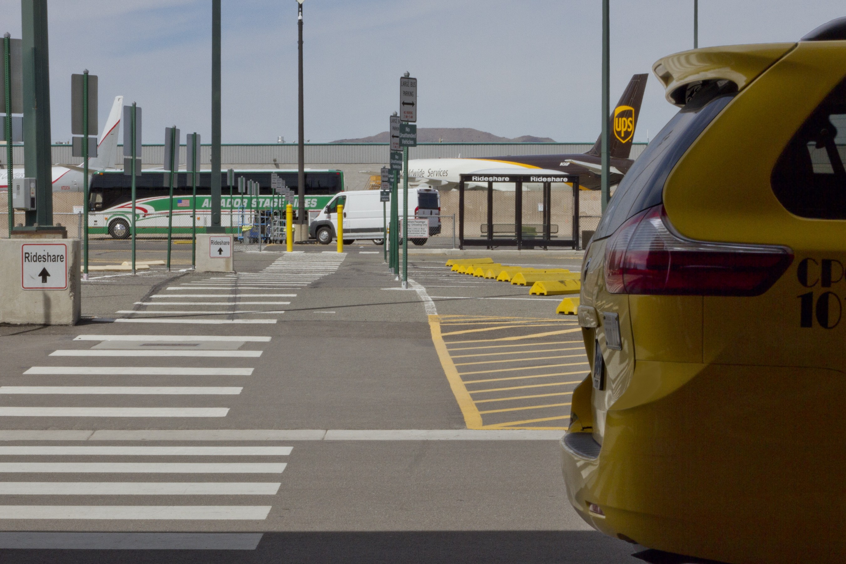 Beyond Taxi Line, Path Leads to Ride-share Shelter at Airport Photo