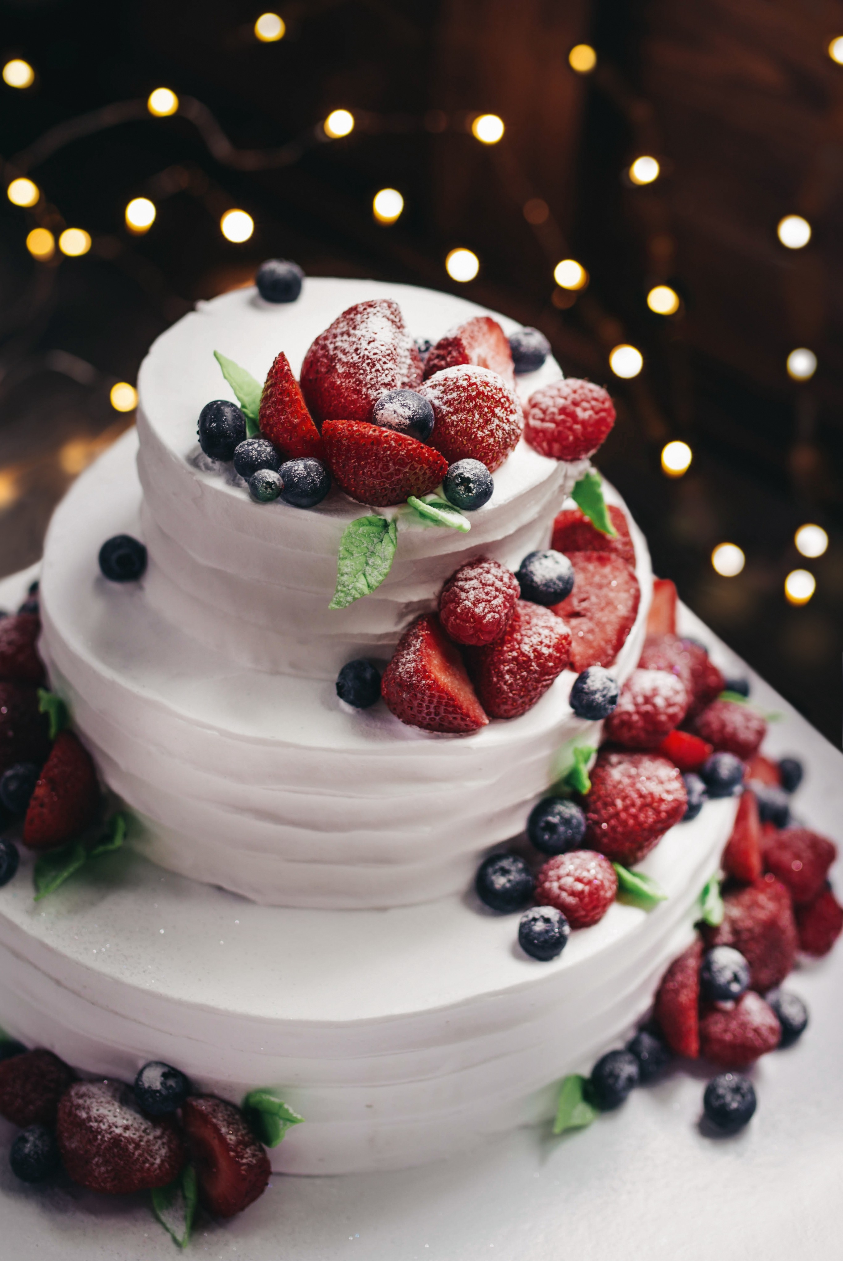 berries on a white cake