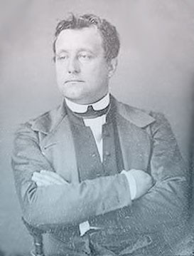 Bo wears a dark suit with his arms crossed over his chest. His face looks like his uncle Napoleon's.