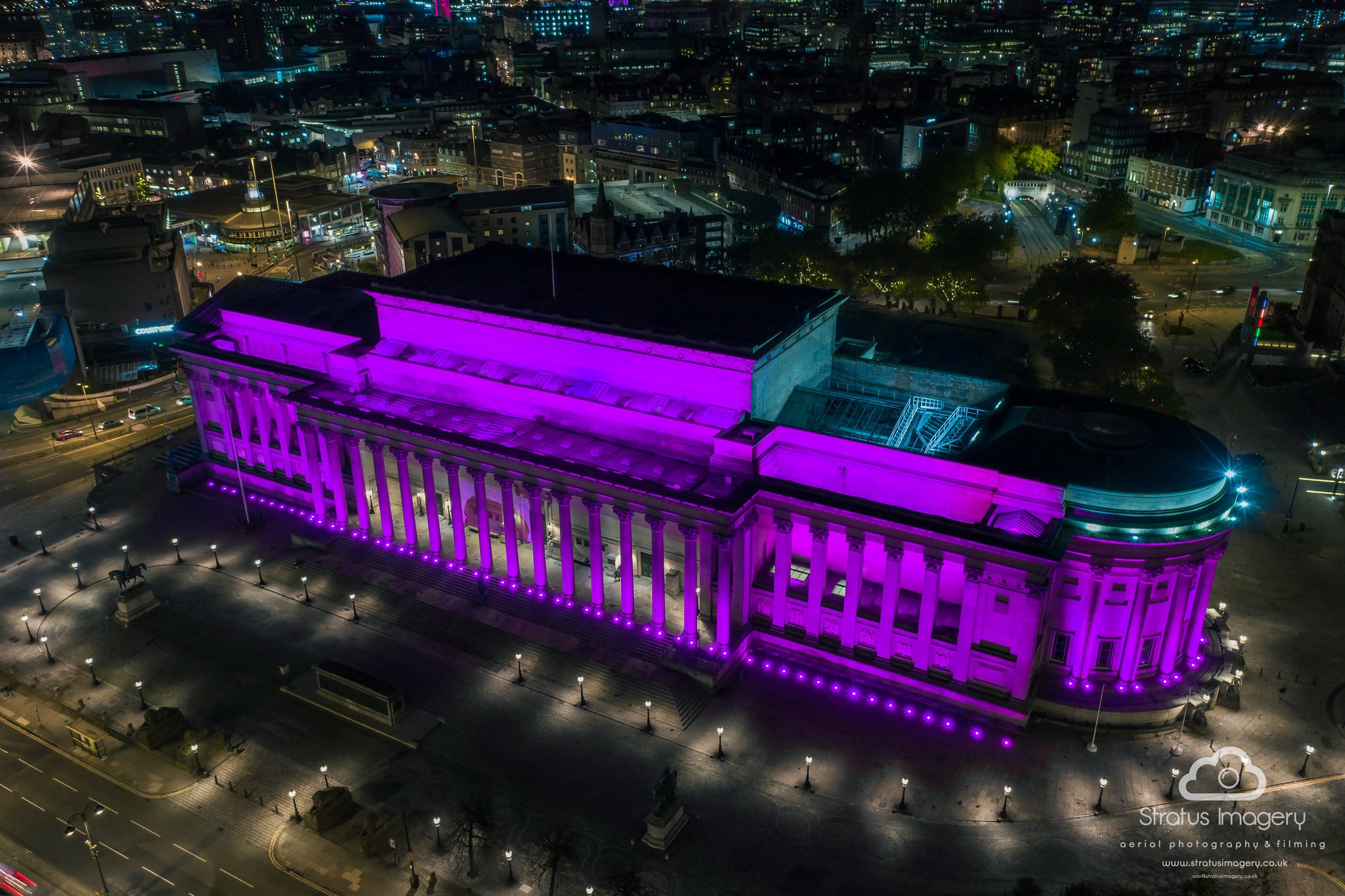 St George's Hall lit in purple light featured in an arial photograph at night