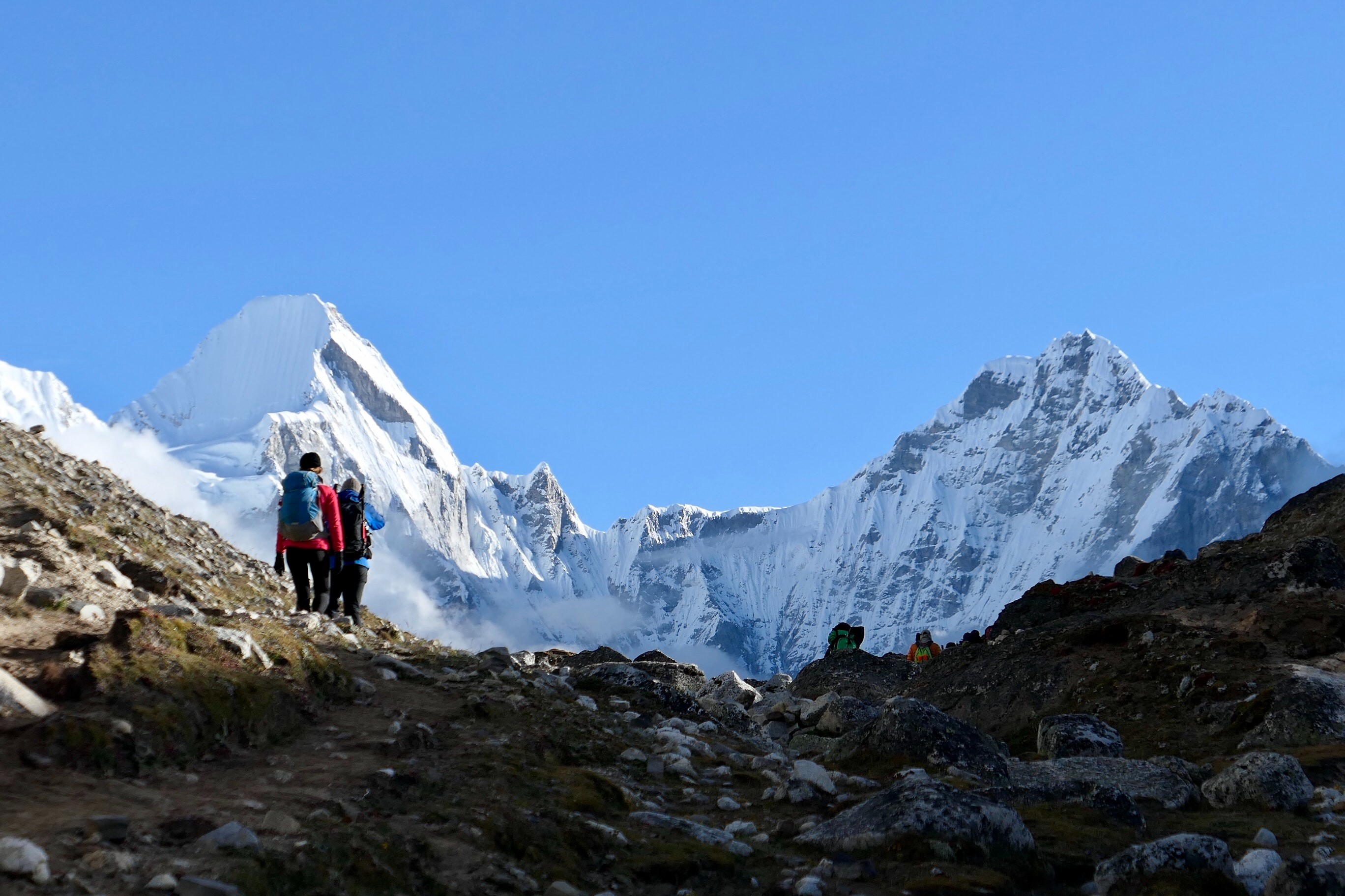 2 hikers walking towards the summit of Mount Everest
