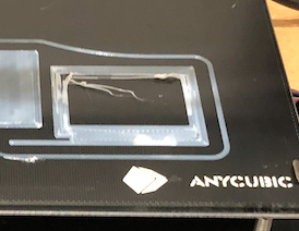 This is what non-adhesion looks like. When PLA does not stick to the print bed, air bubbles form between print and the bed