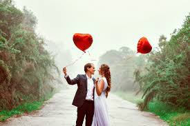 signs a sagittarius man is falling in love with you image