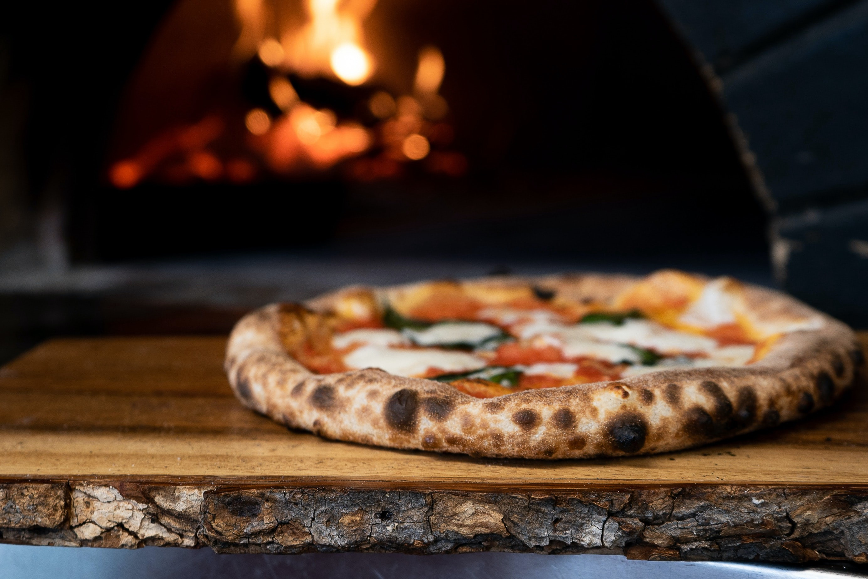 Wood-fired pizza pie.