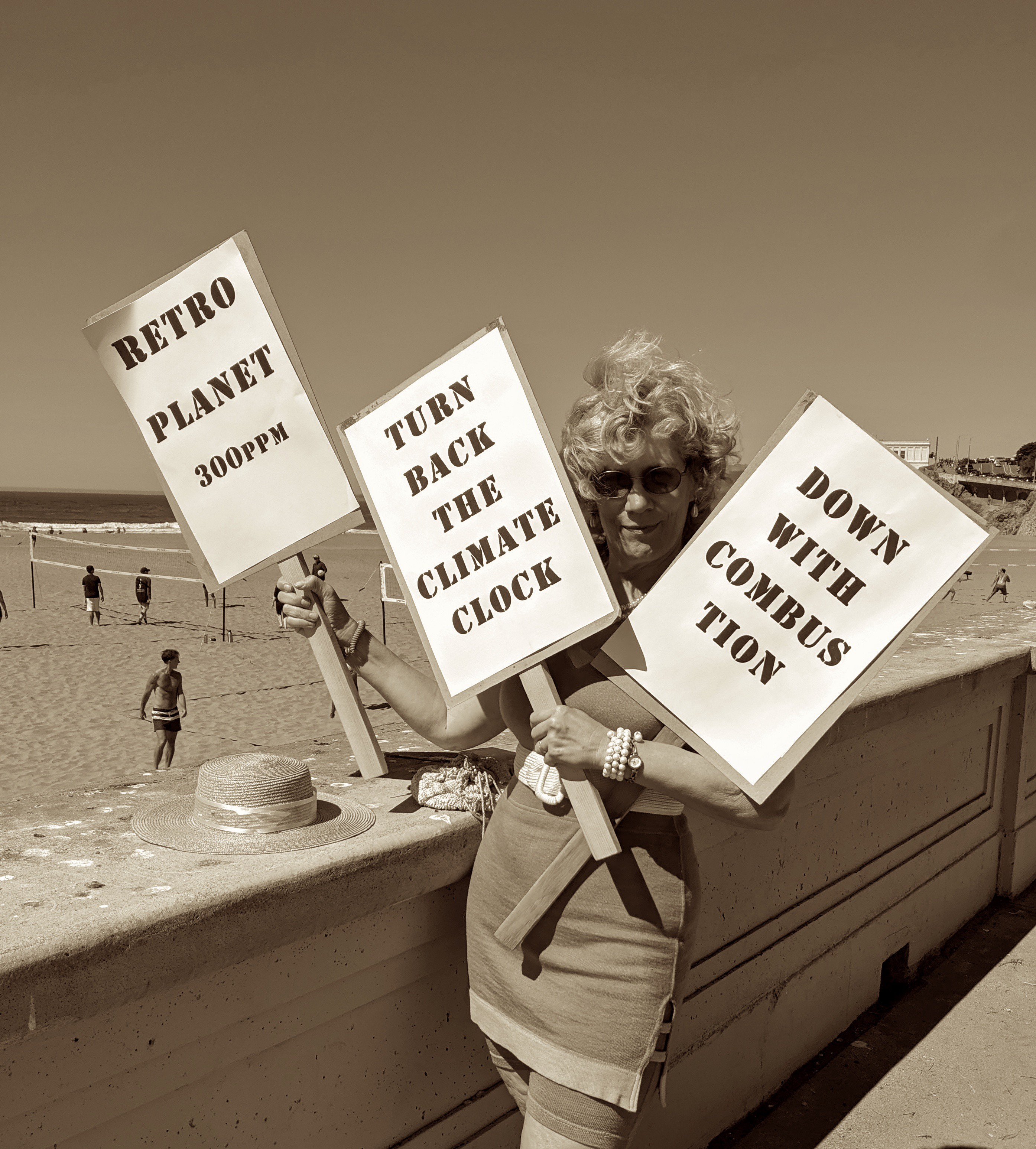 "Costumed climate protest signs: ""Retro Planet — 300ppm,"" ""Turn Back the Climate Clock"" and ""Down With Combustion."""