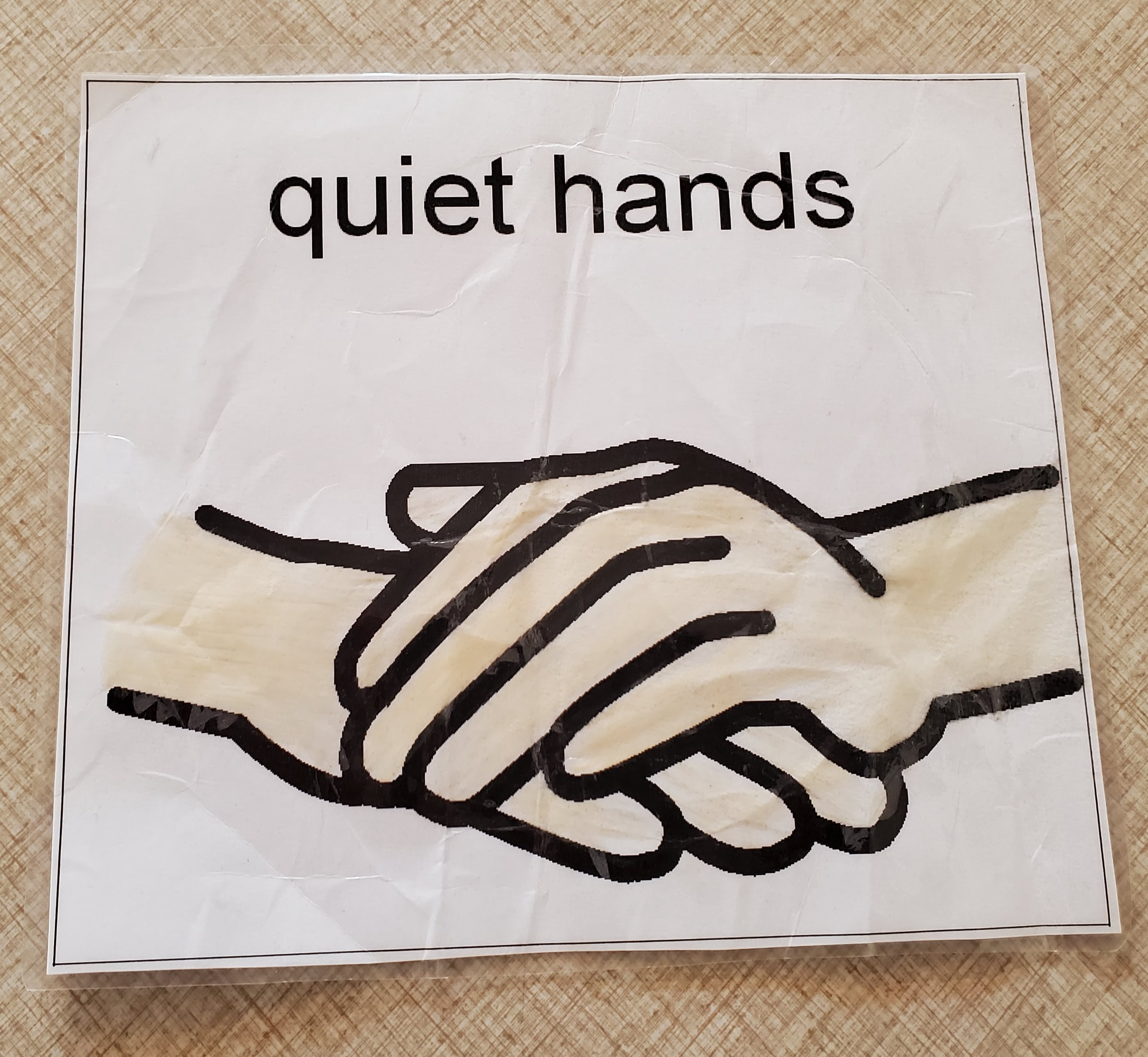 """Simple drawing of a pair of hands with one on top of the other and the heading, """"Quiet Hands."""""""