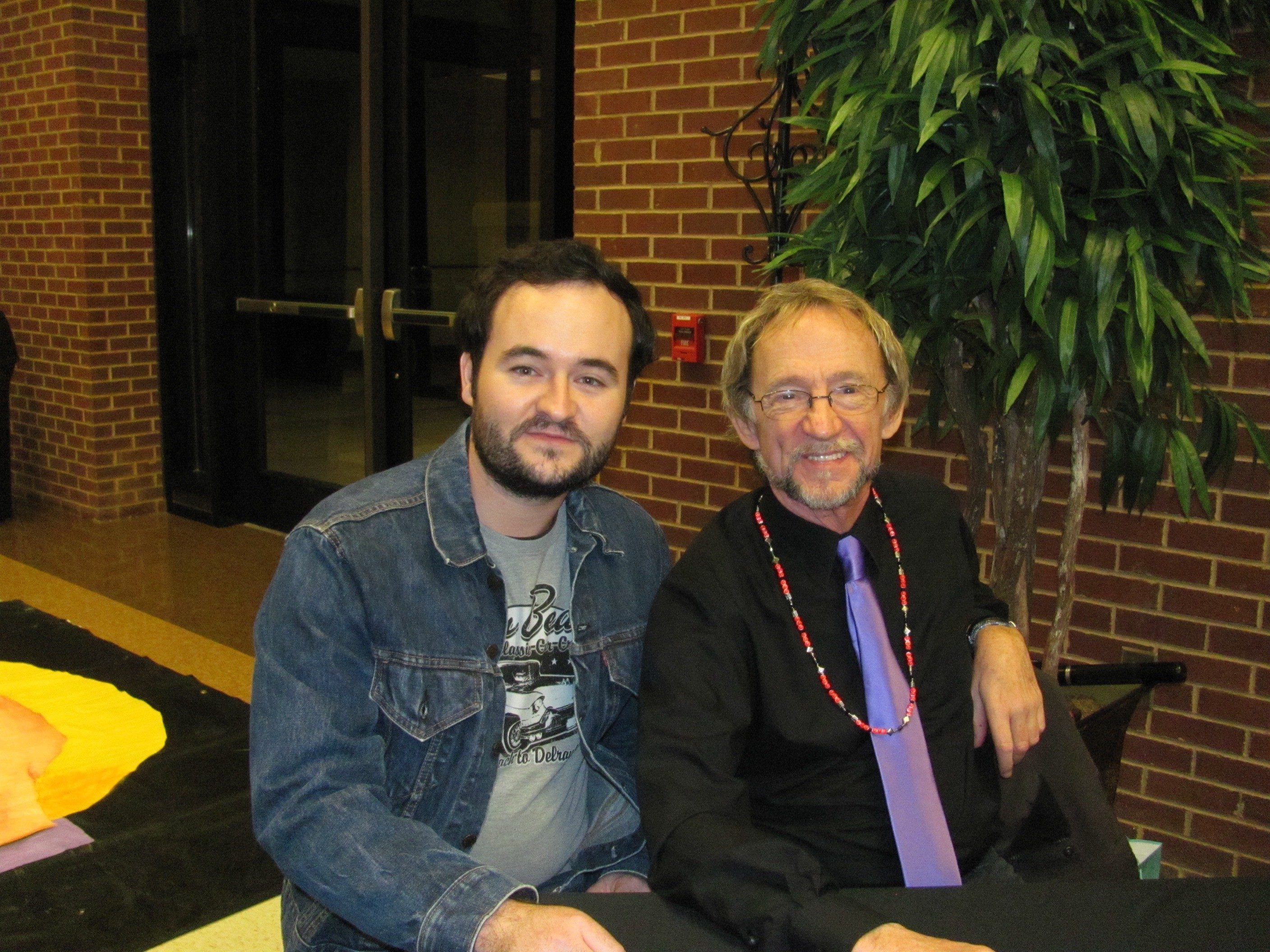 Monkees bassist Peter Tork meets a dyed in the wool fan during a solo Shoe Suede Blues concert in Adel, Georgia, in 2011.