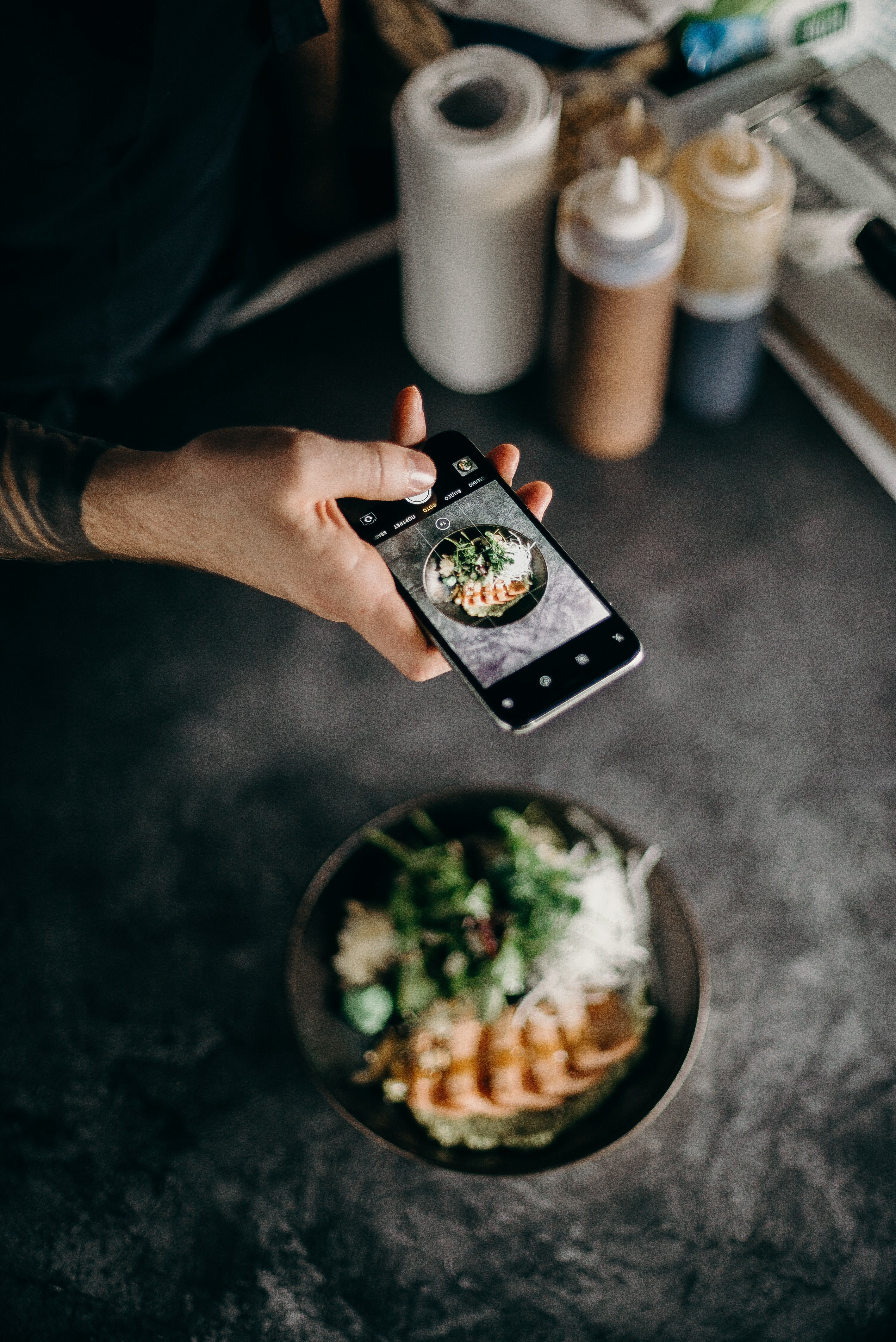 Man taking a photo of his food with his phone