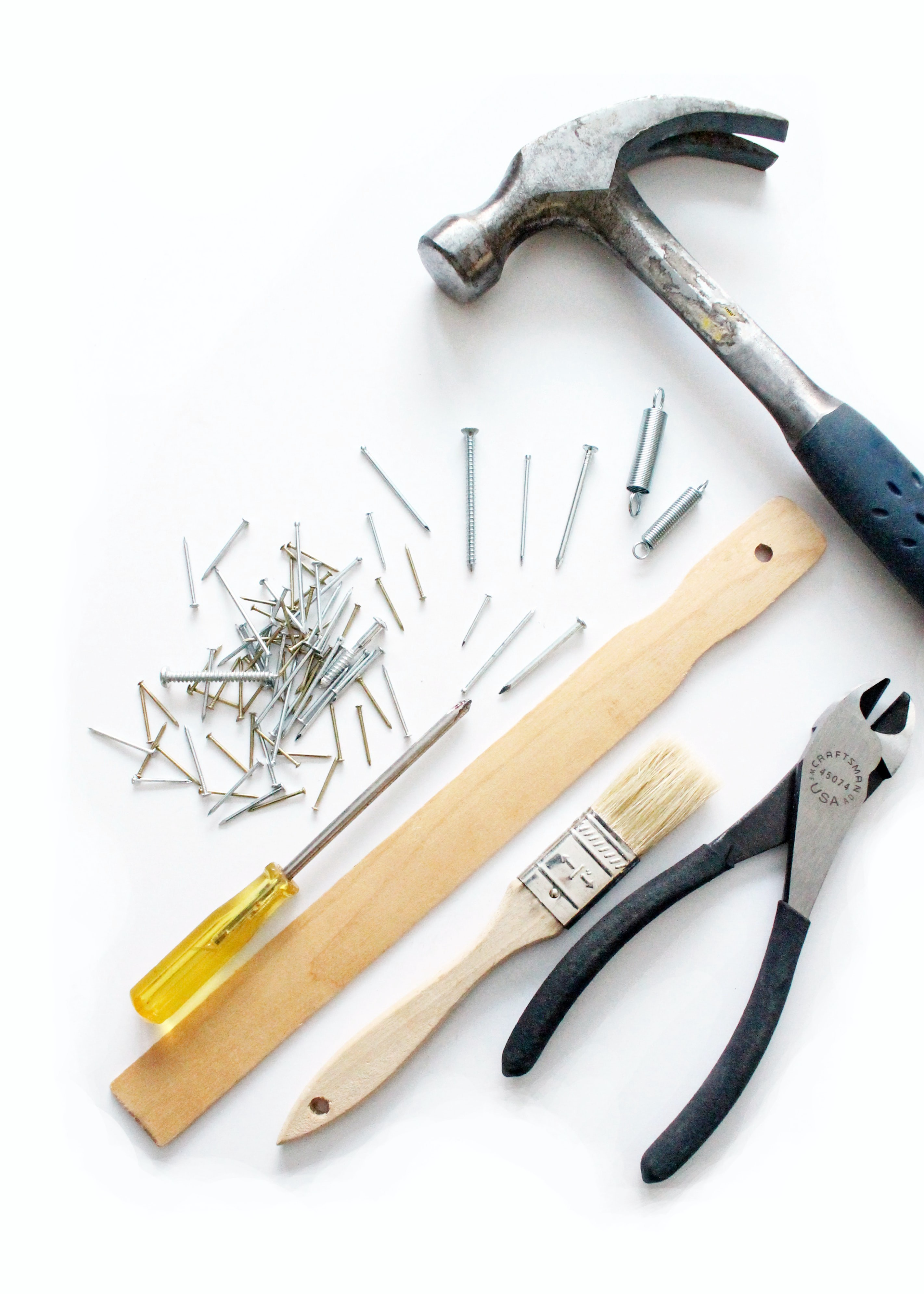 picture of nails, hammer, paint brush