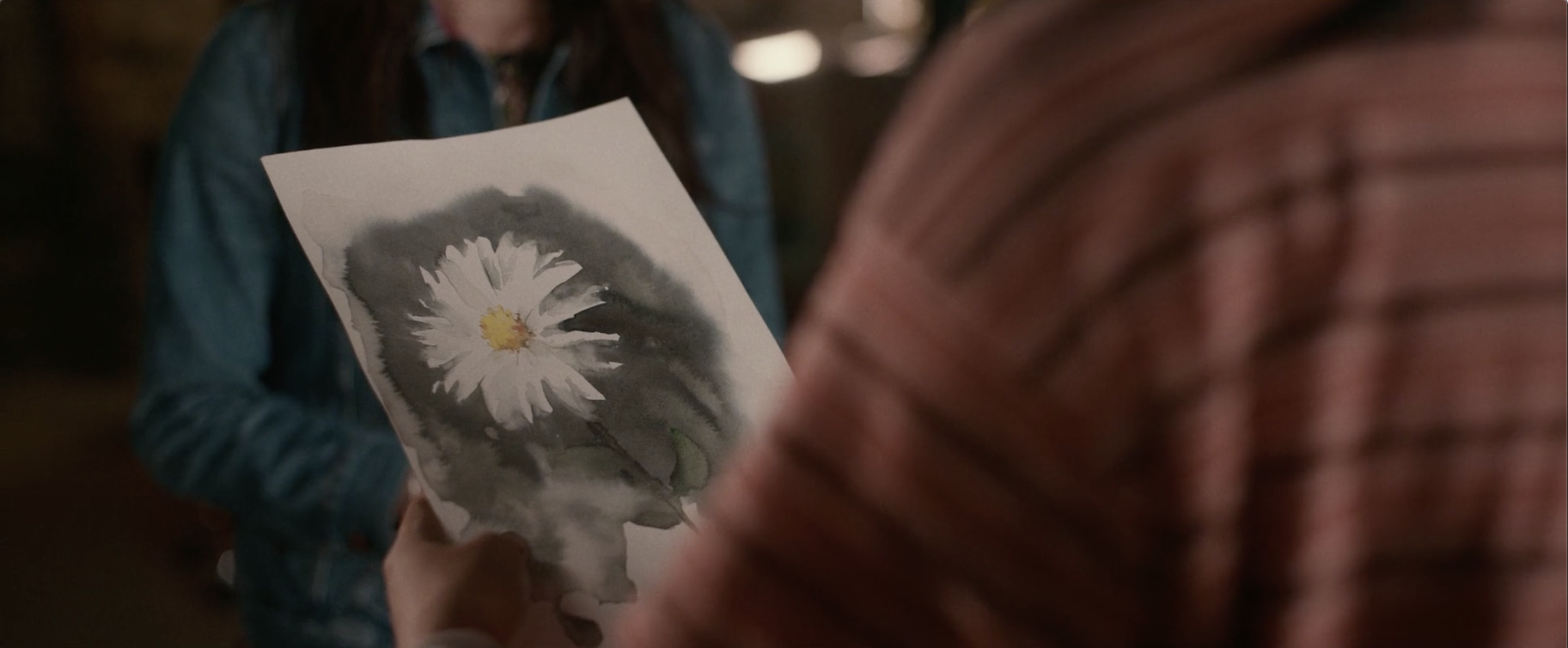 Ellie looks at Aster's painting in The Half of It