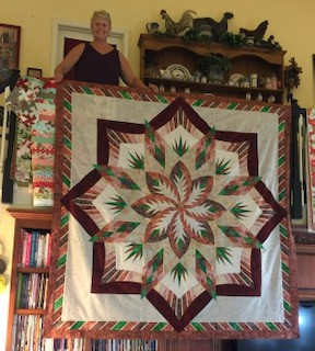 A large hanging quilt. Art and crafts build our mental health.